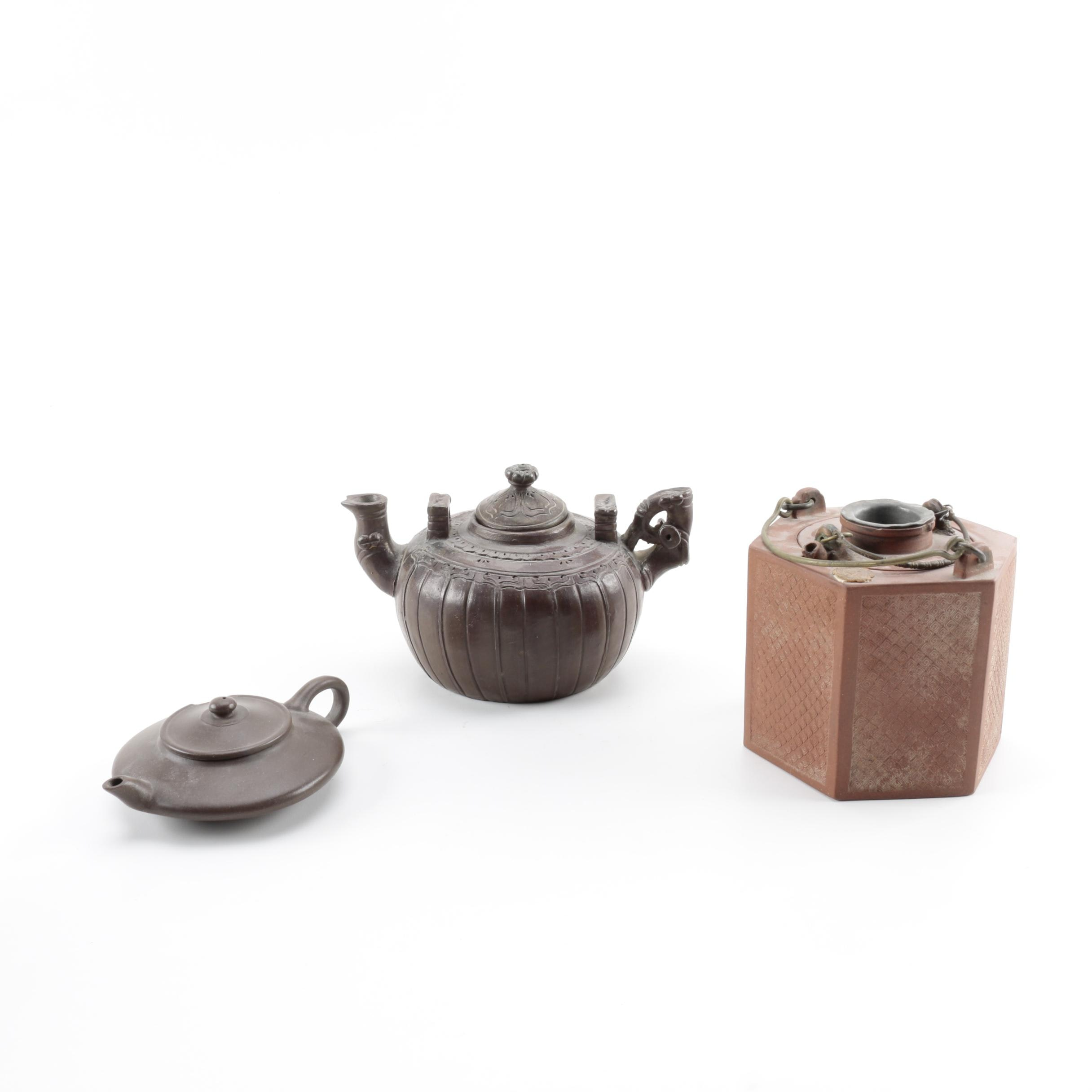 Assorted East Asian Teapots Including Yixing Teapot