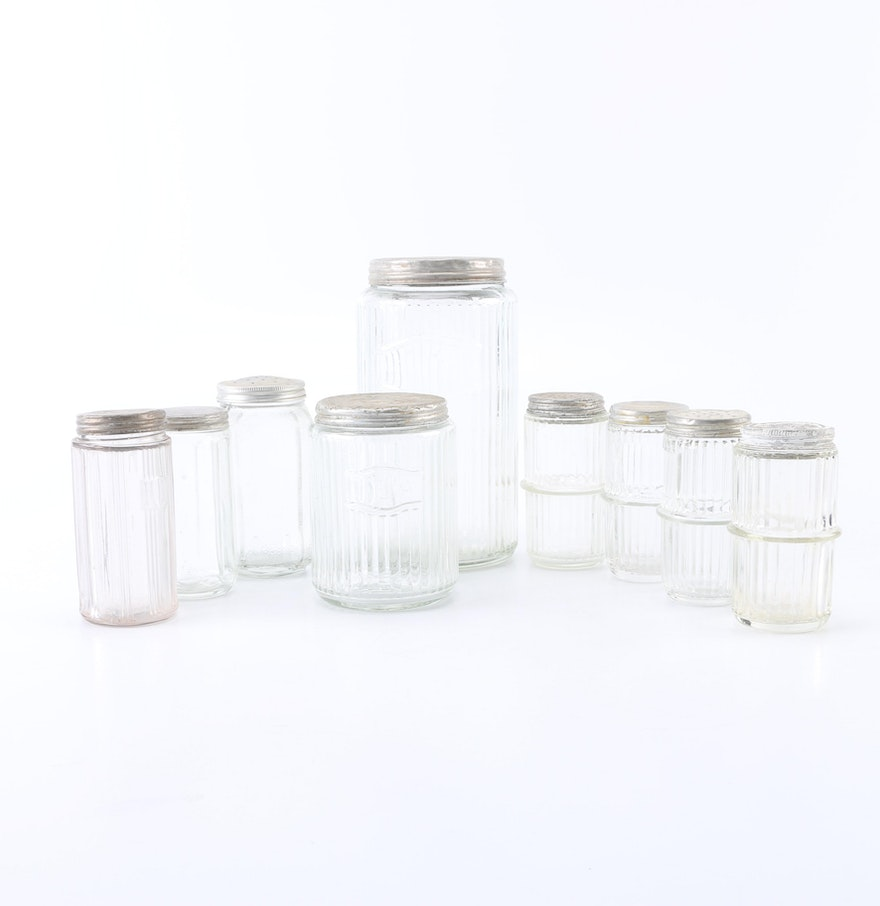 Assortment of vintage glass kitchen canisters ebth for Glass bathroom canisters