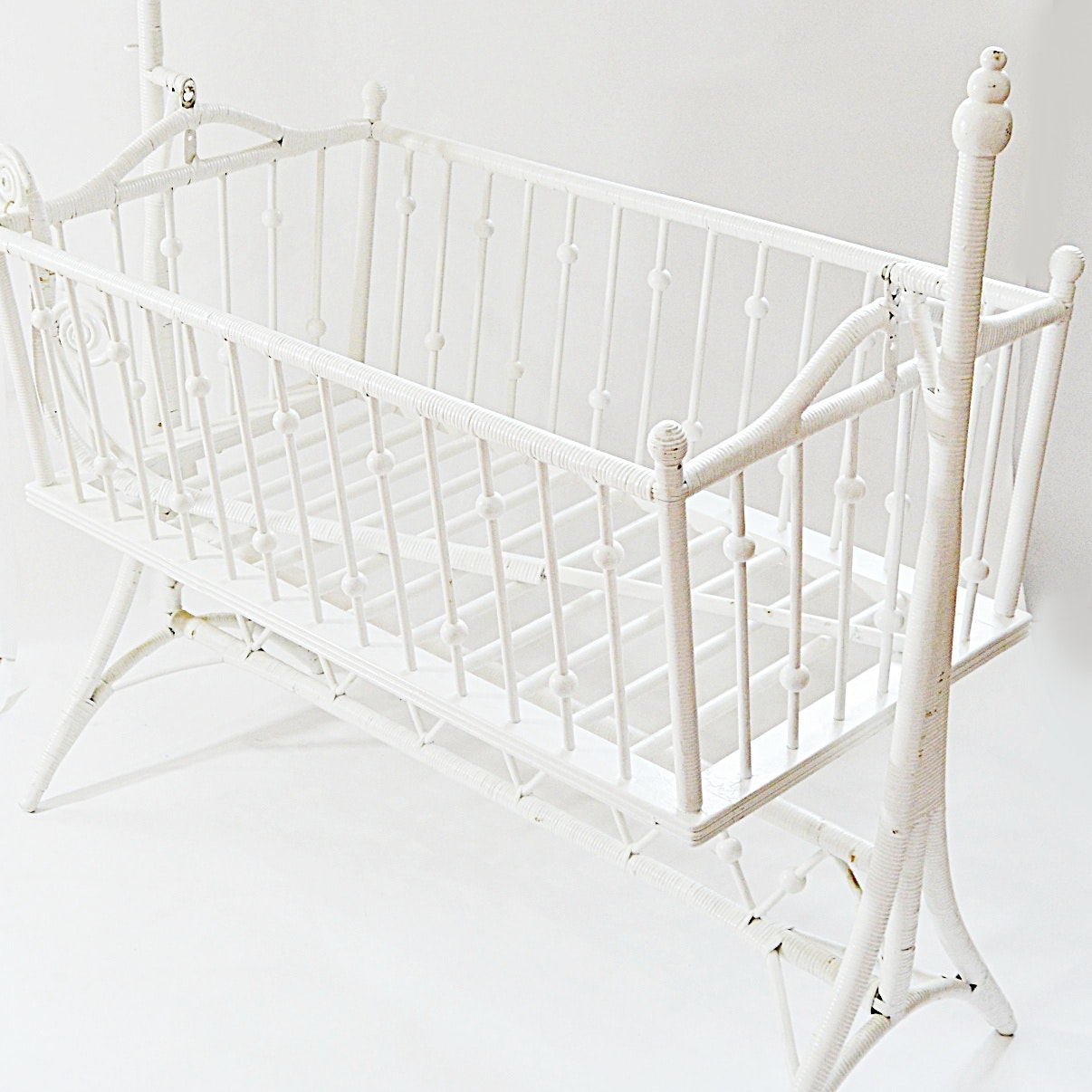 Victorian Ball and Stick White Wicker Baby Cradle