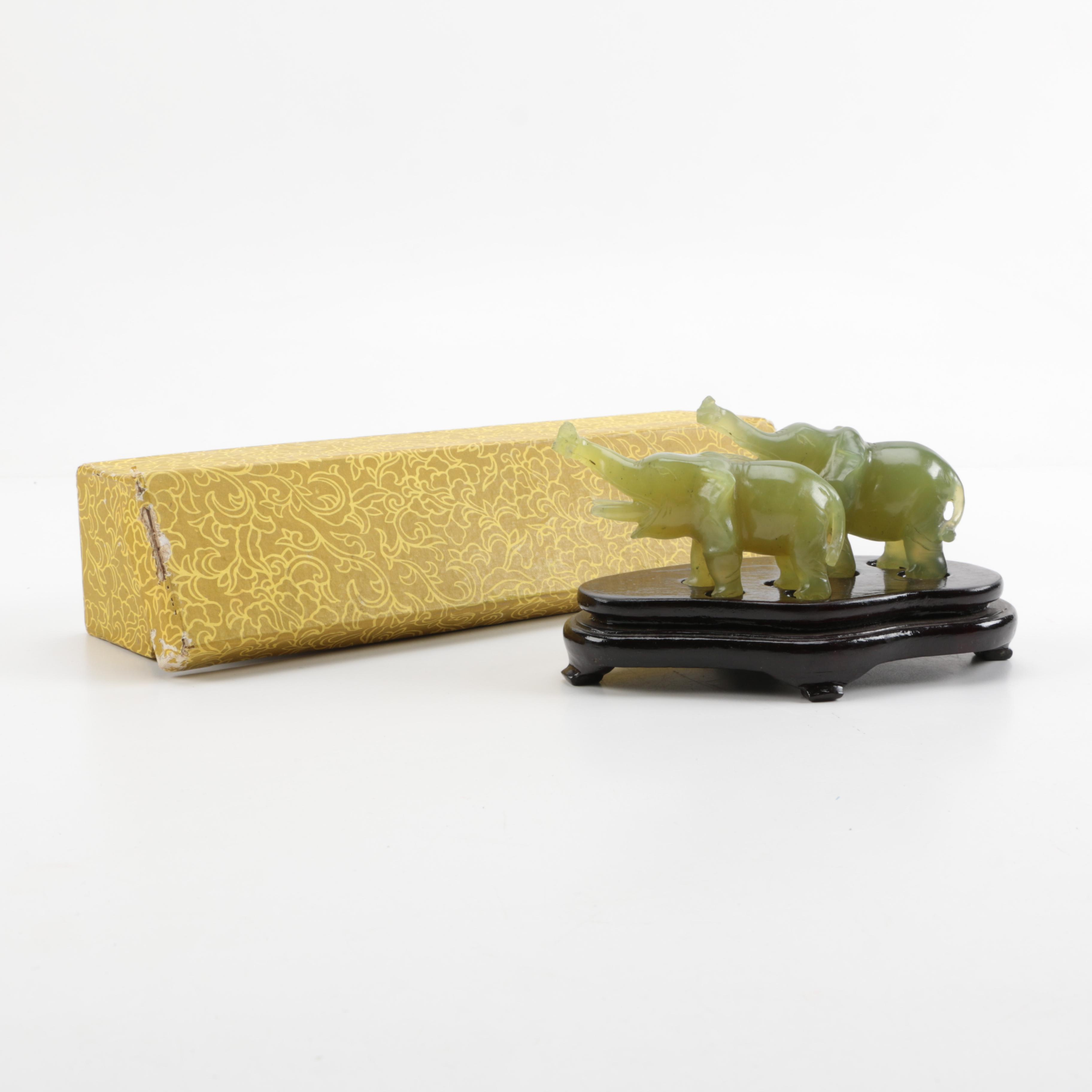 Chinese Carved Pair of Elephant Figurines With Stand