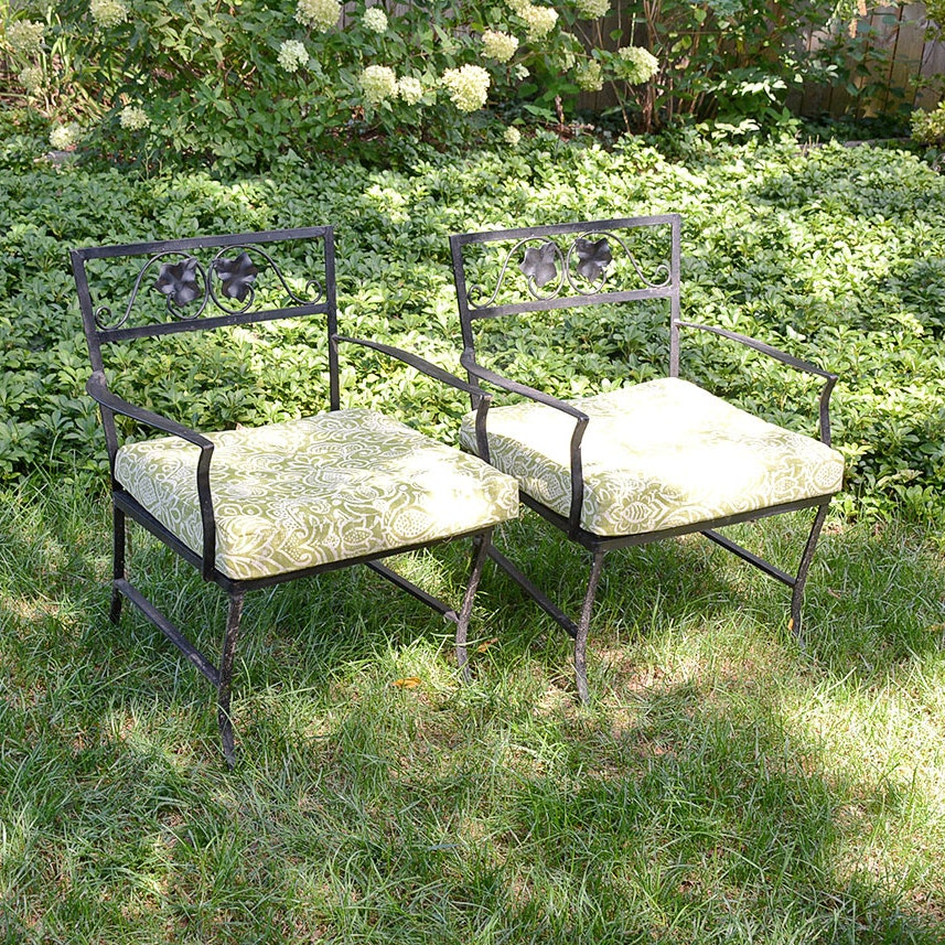 Two Iron Patio Chairs with Green Upholstered Cushions