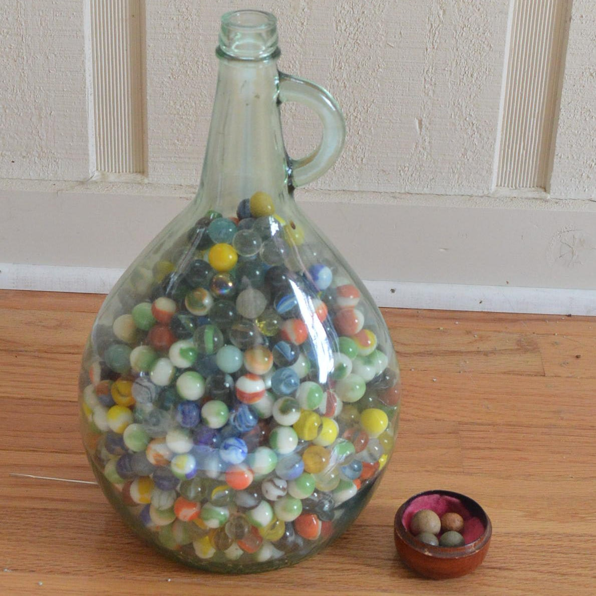 Jug of Marbles Featuring Antique Clay Marbles