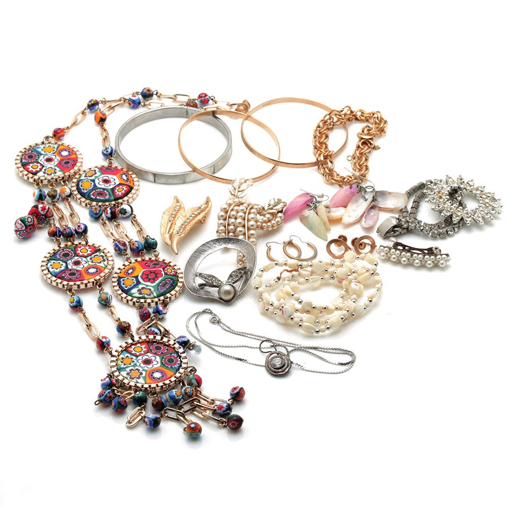 Colorful Assortment of Jewelry Featuring Sterling Silver, Shell, Rhinestones, and Imitation Millefiori