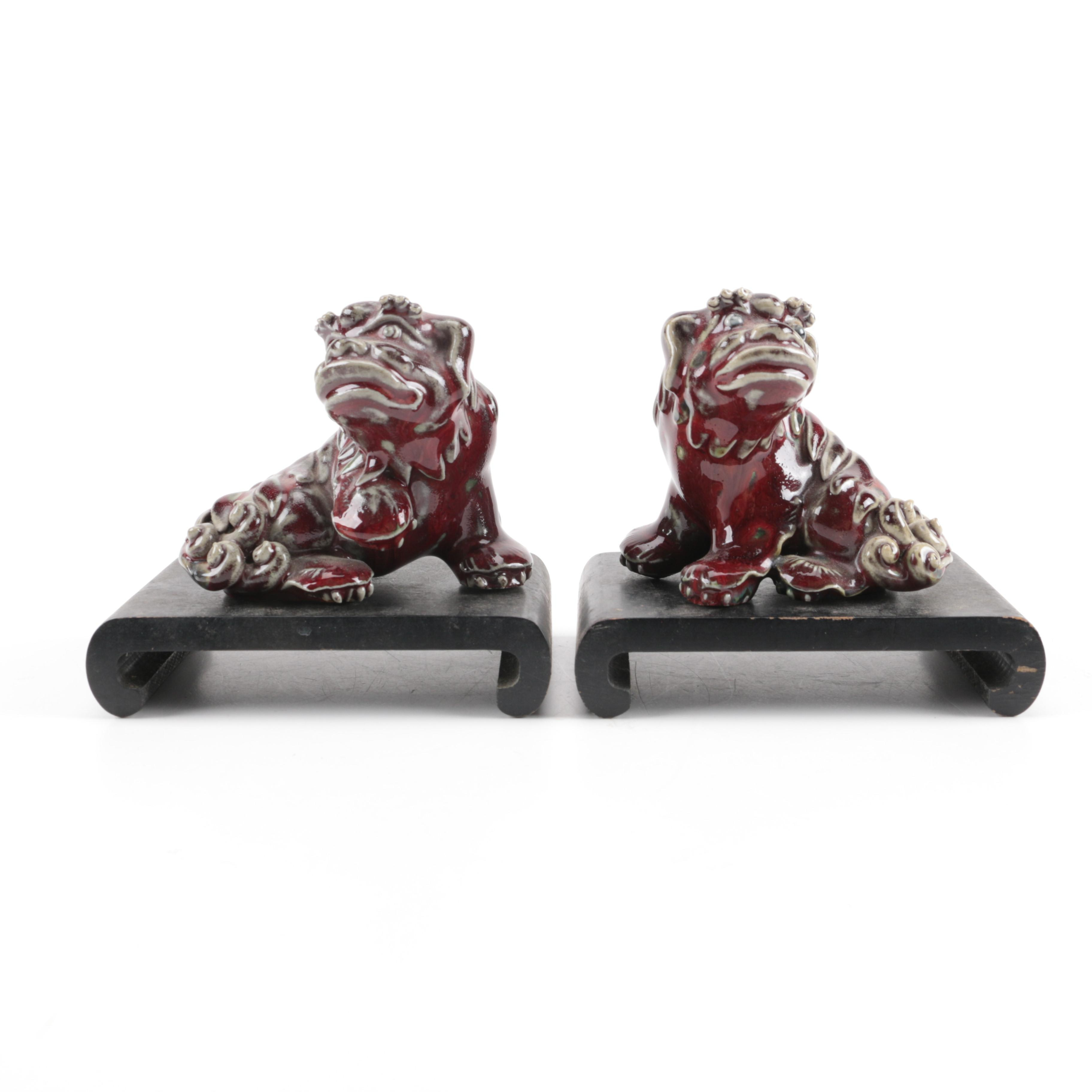 Pair of Ceramic Foo Dogs on Wooden Bases