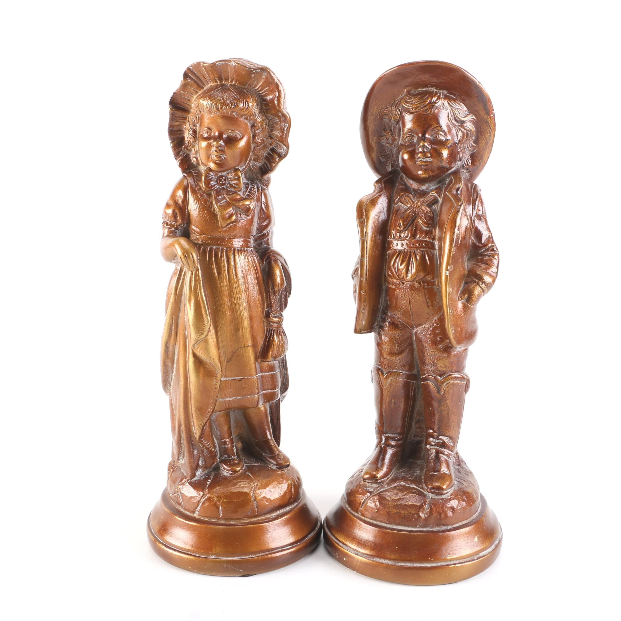 Pair of Jaru Boy and Girl Statues