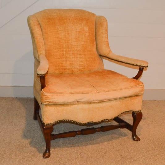 Peach-Colored Wingback Armchair