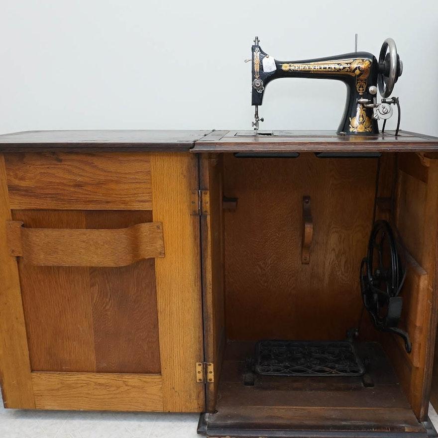 antique oak sewing cabinet and franklin sewing machine ebth. Black Bedroom Furniture Sets. Home Design Ideas