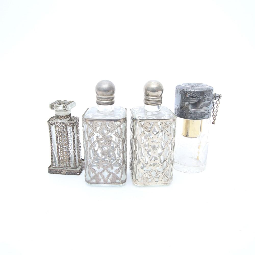 Assortment of Vintage Perfume Bottles featuring Metal Overlays