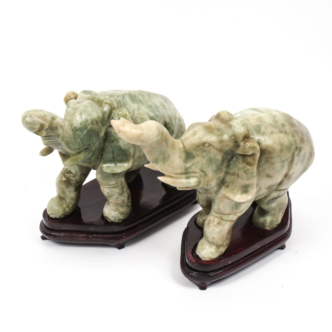 Pair of carved green stone elephants ebth