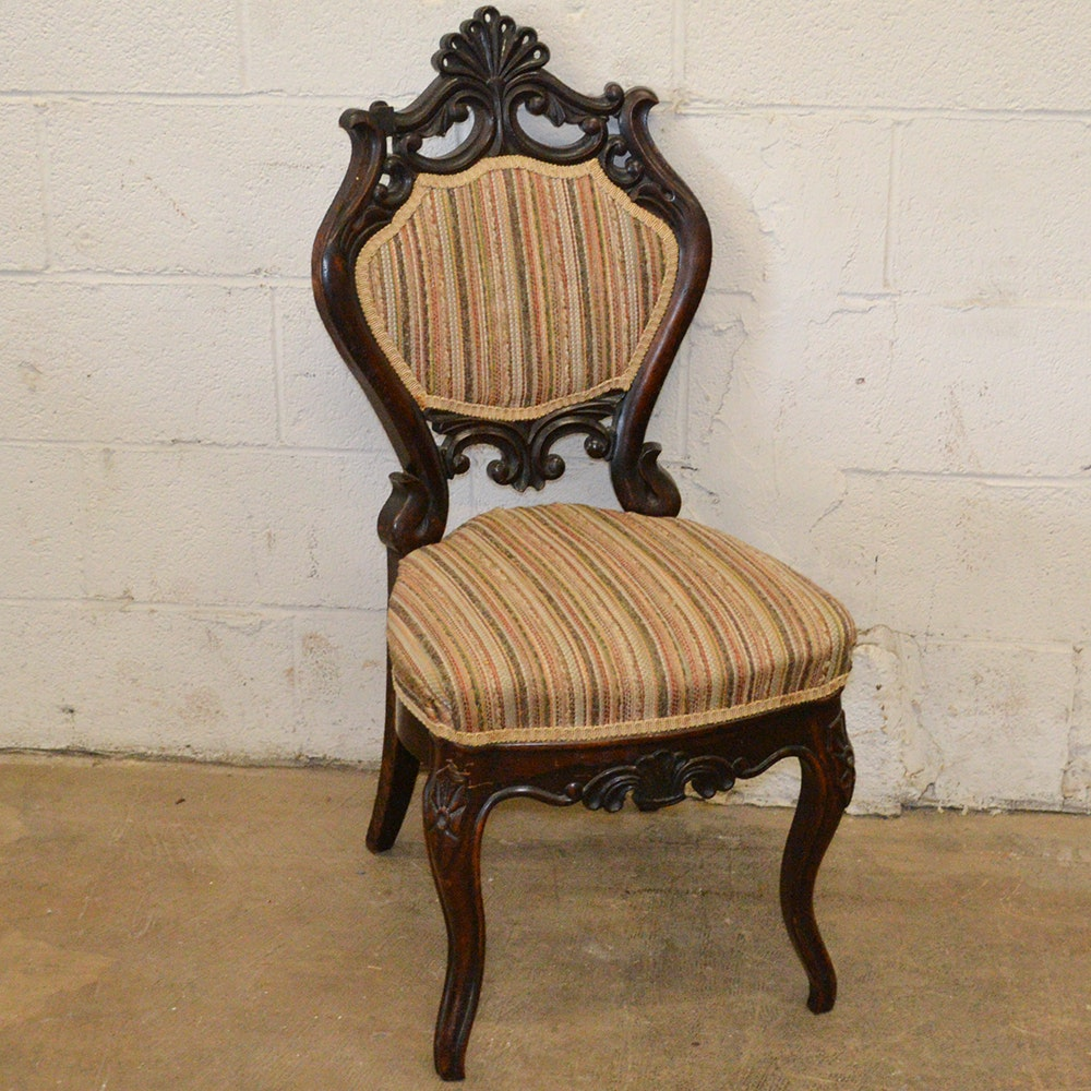 Ornately Carved Side Chair With Striped Upholstery