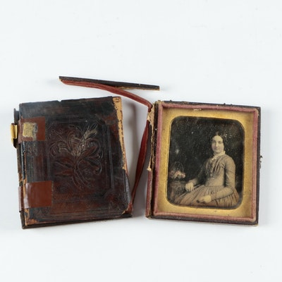 Antique Photographs of a Man and a Woman with Cases
