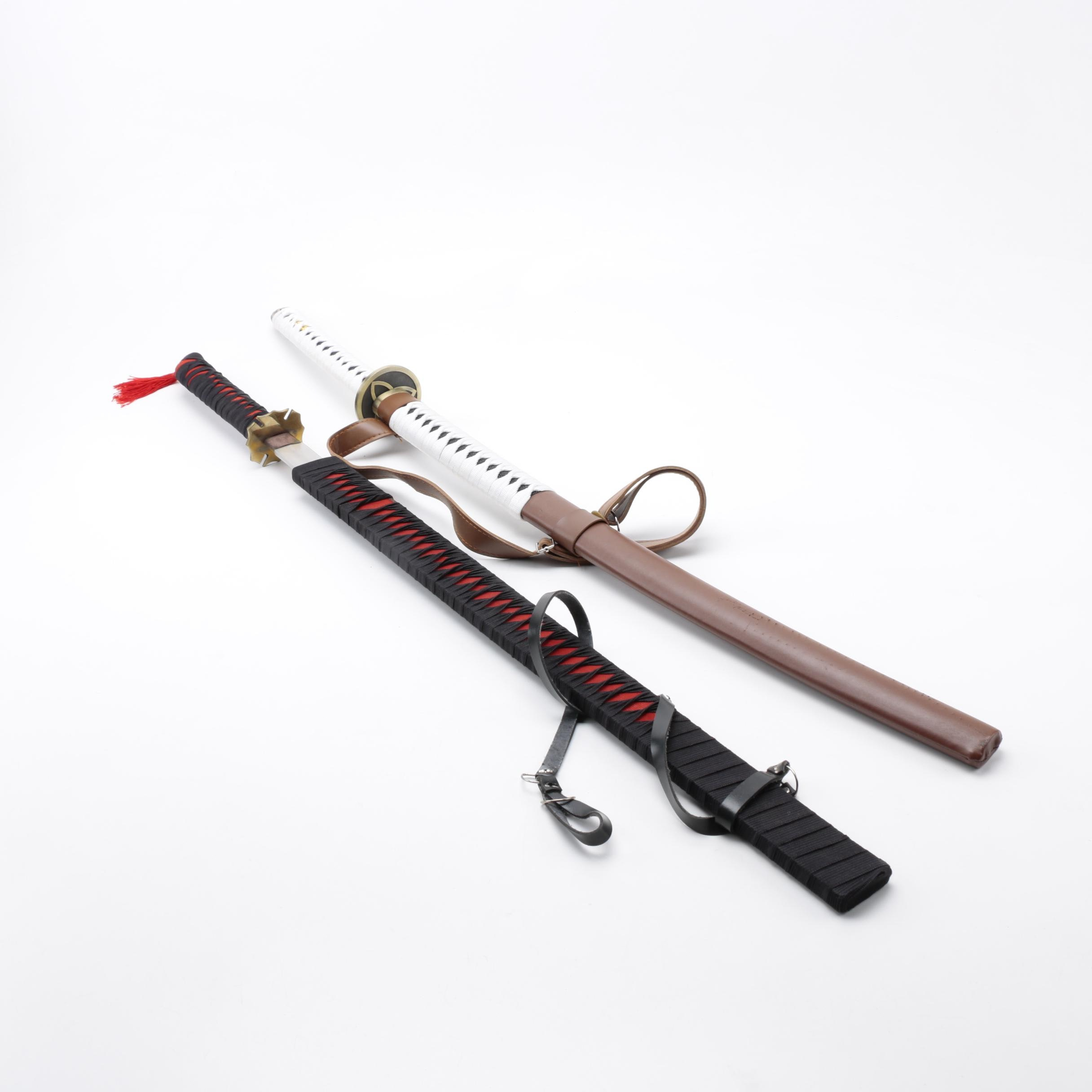 Pair of East Asian Swords in Scabbards
