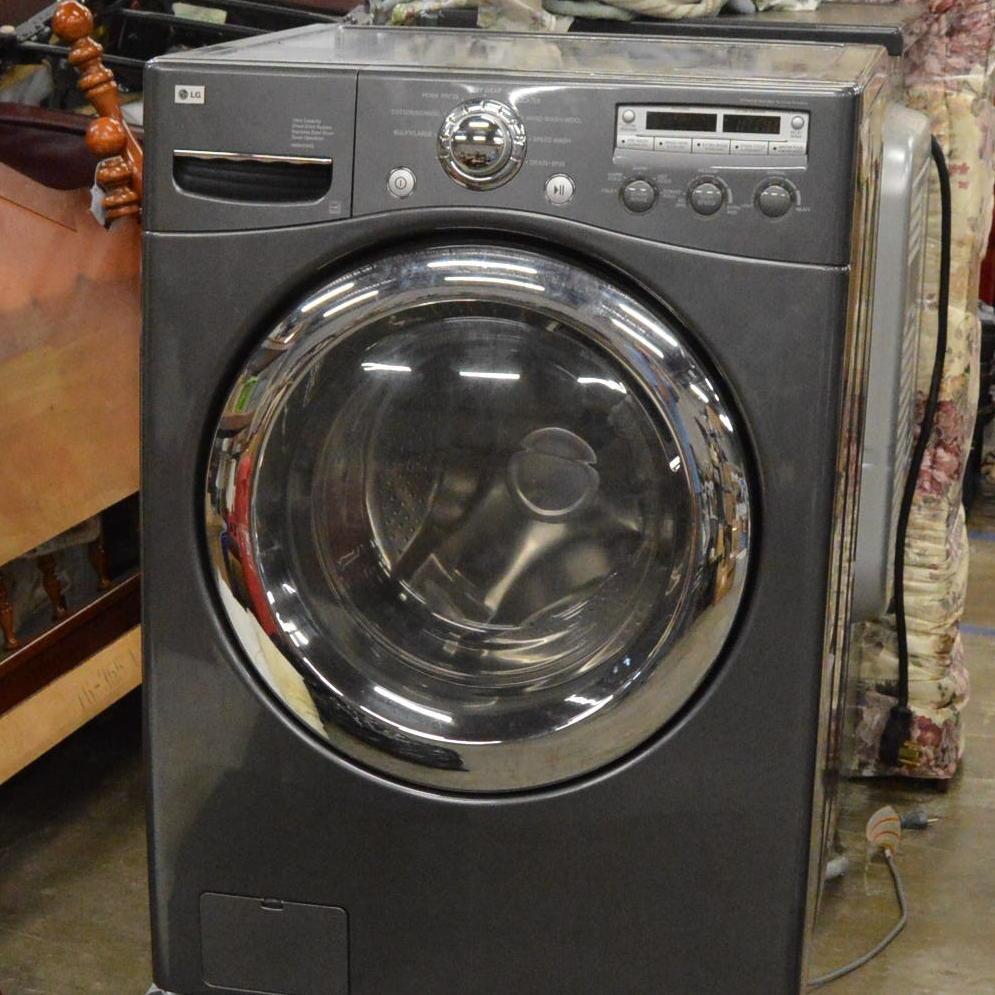 lg frontload washing machine on base