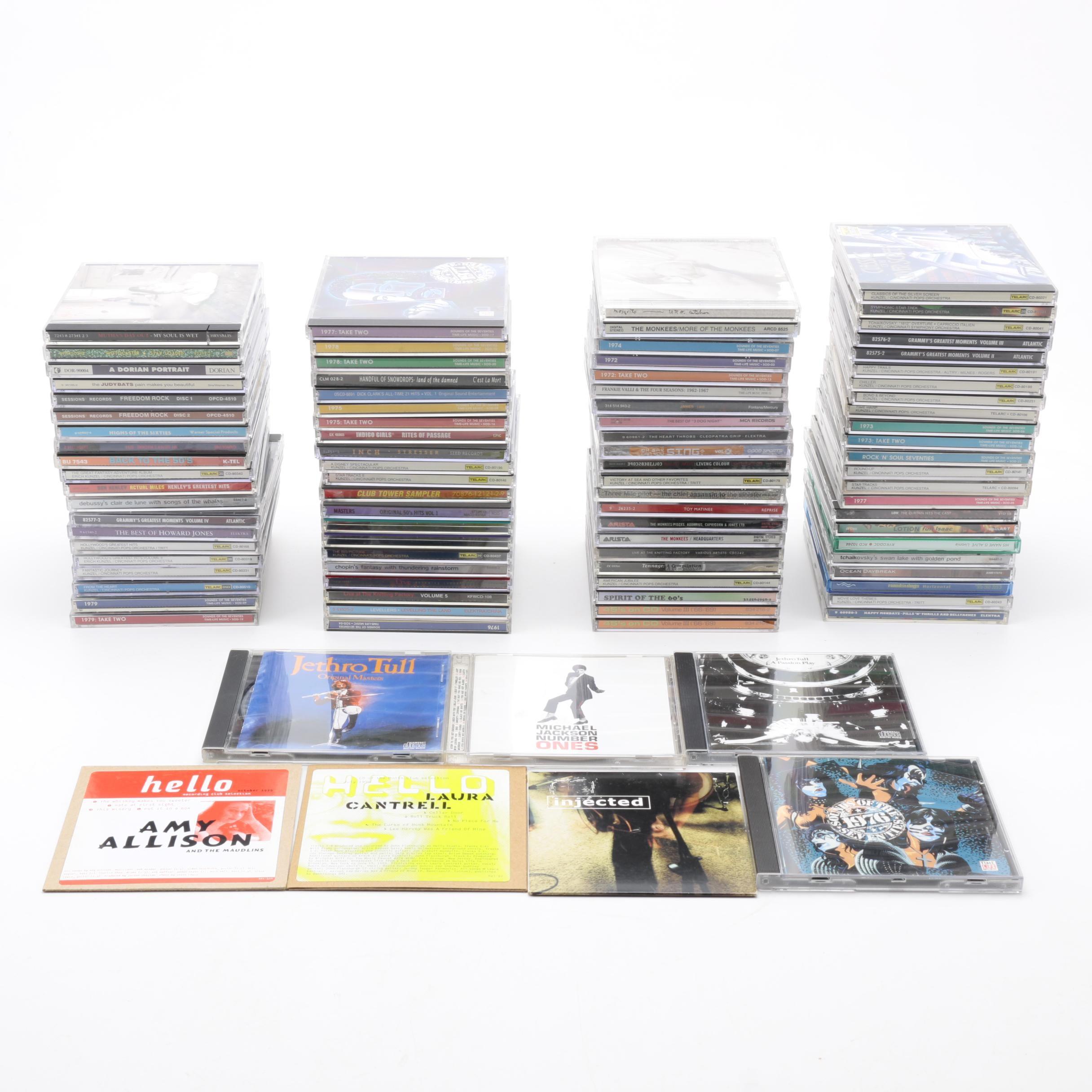 Large Assortment of CDs, including Elton John, Pink Floyd, and 24K Gold CDs