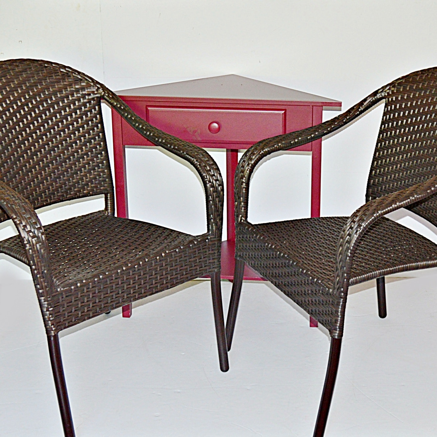 Two Frontgate Woven Vinyl Chair and Red Painted Triangular Corner Table