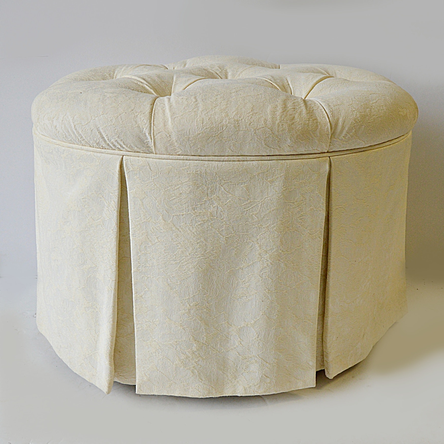 Oval Button-Tufted Ottoman