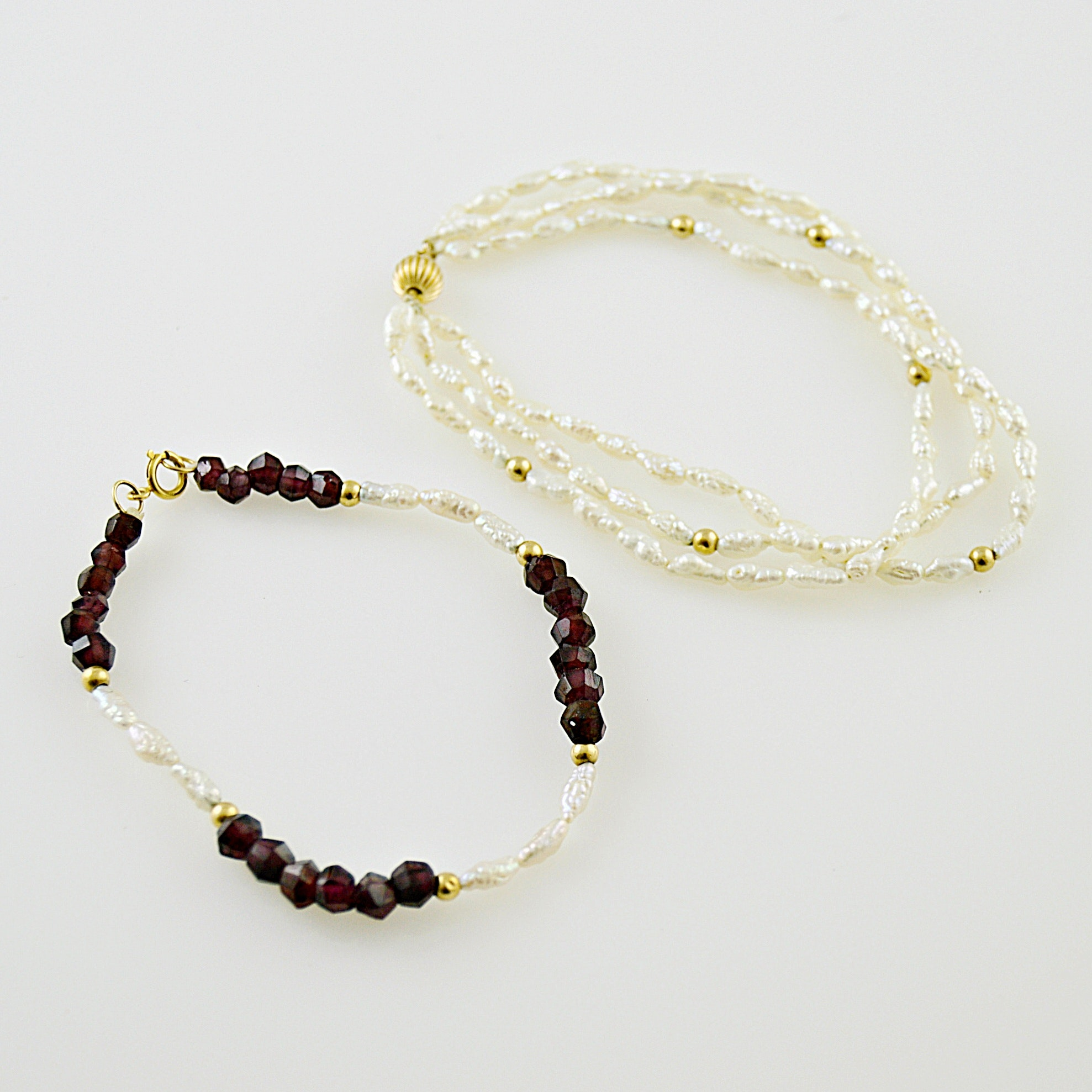 Two 14K Gold and Baroque Pearl Bracelets, One with Garnets