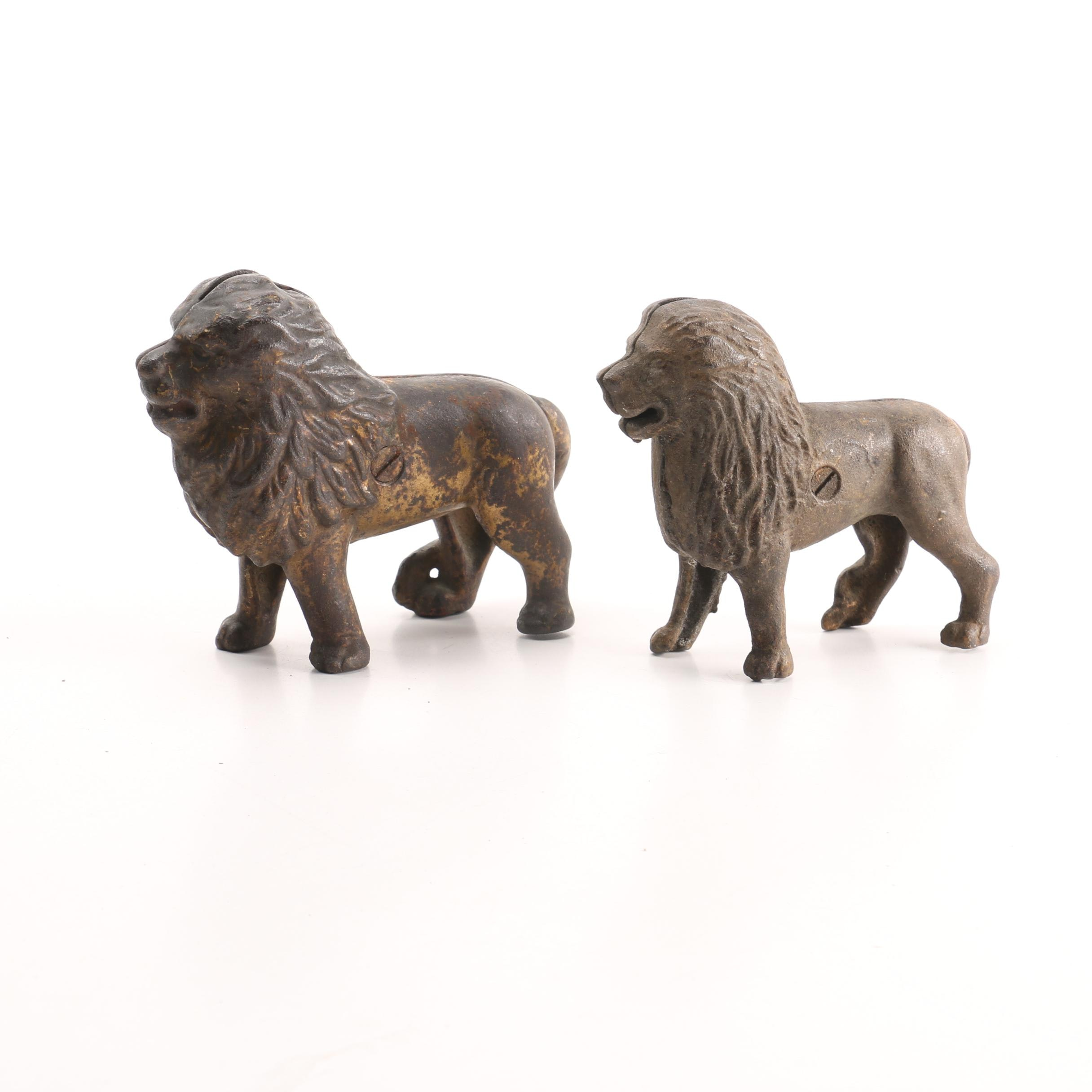 Pair of Antique Cast Iron Lion's Penny Banks
