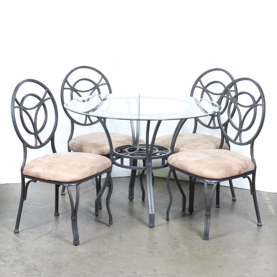 Cast Metal Glass Top Table With Four Chairs ...