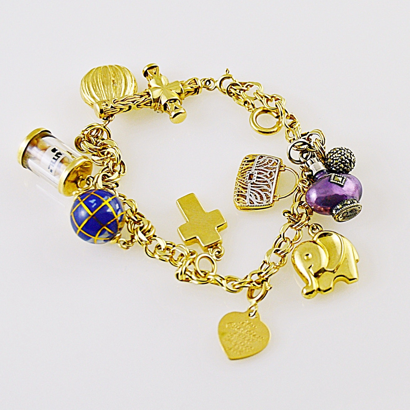 14K Yellow Gold Charm Bracelet with Eight 14K Charms, One Sterling Charm