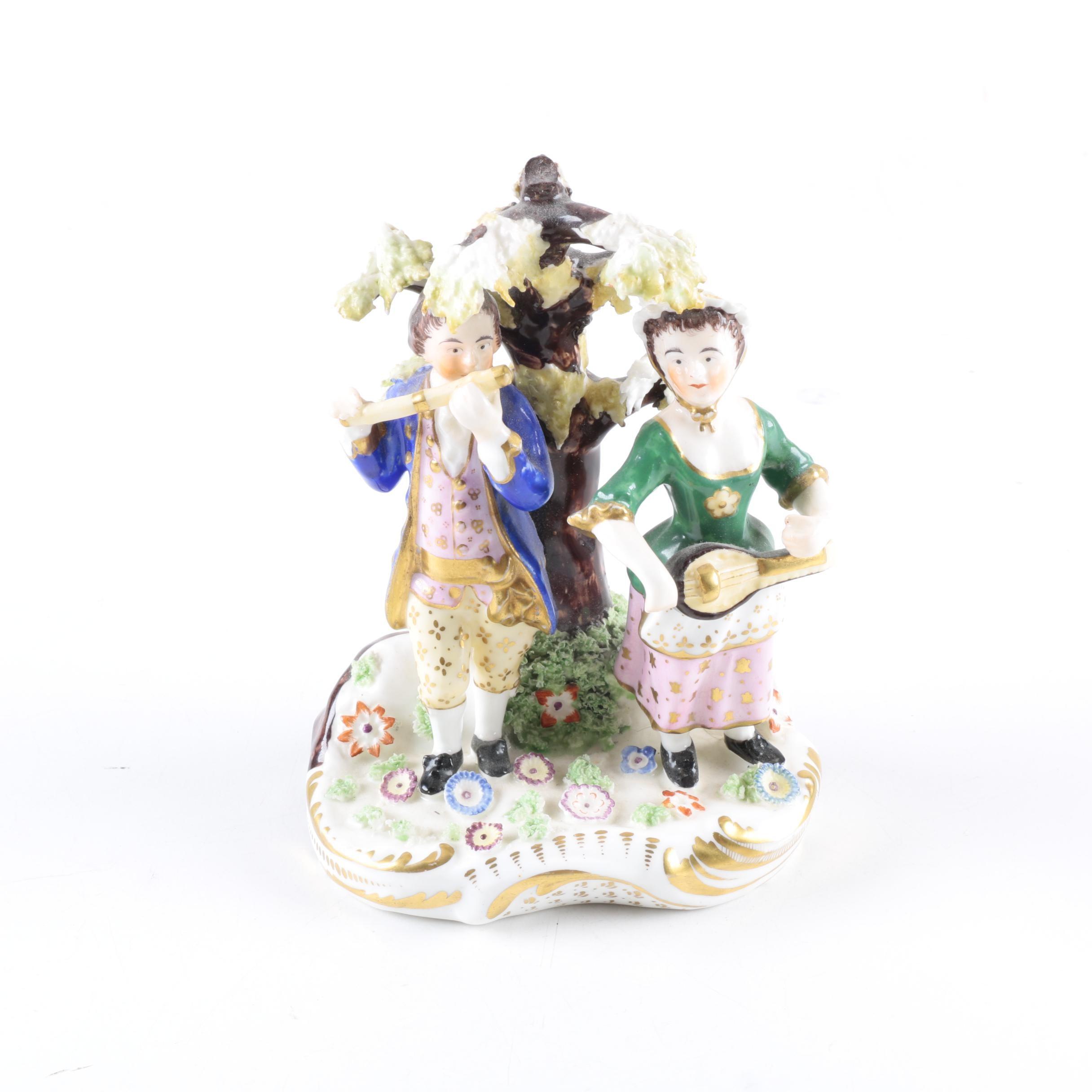 Decorative Porcelain Figurine Depicting a Musical Scene