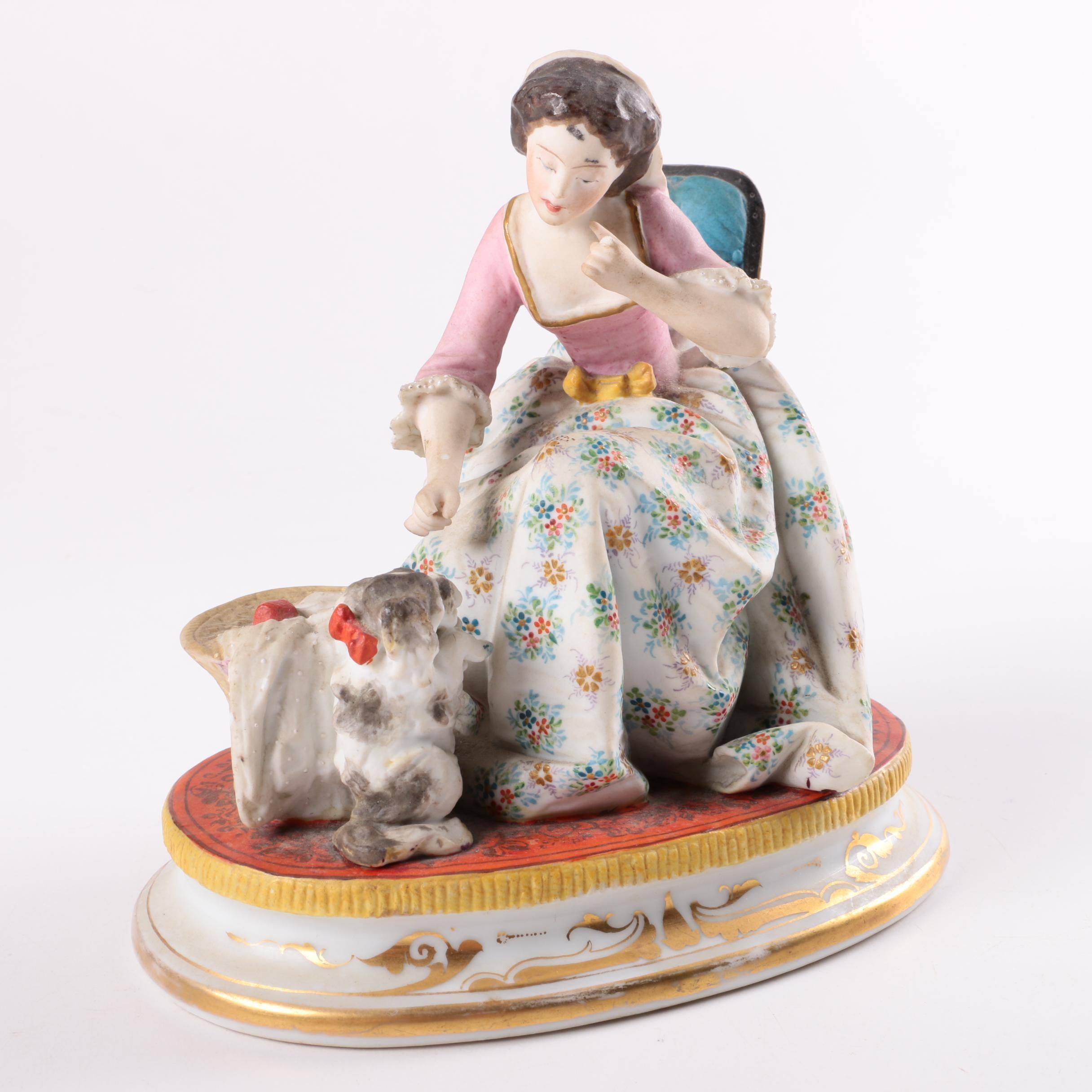 Ceramic Lady Giving Dog A Treat Figurine
