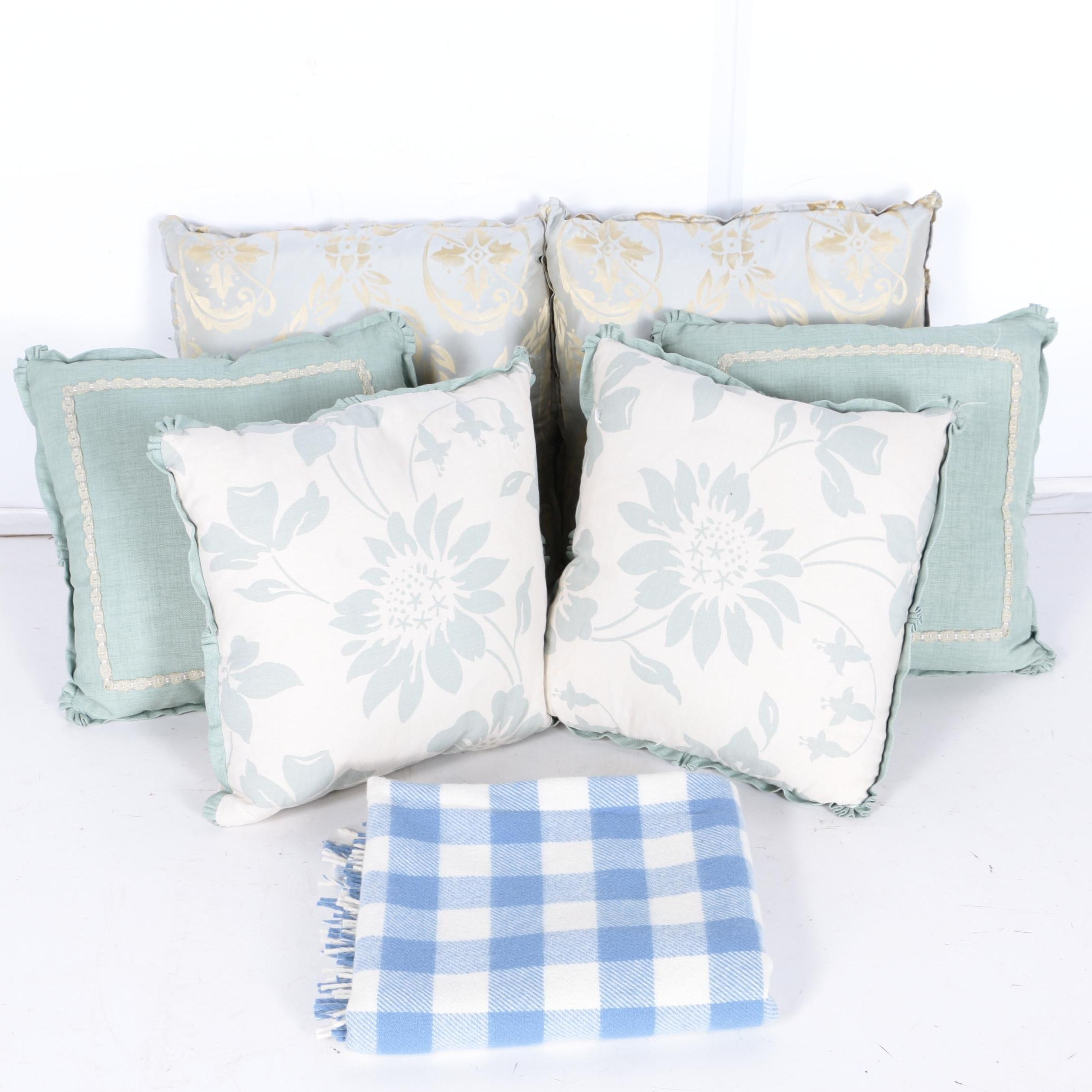 Assortment of Pillows and a Throw