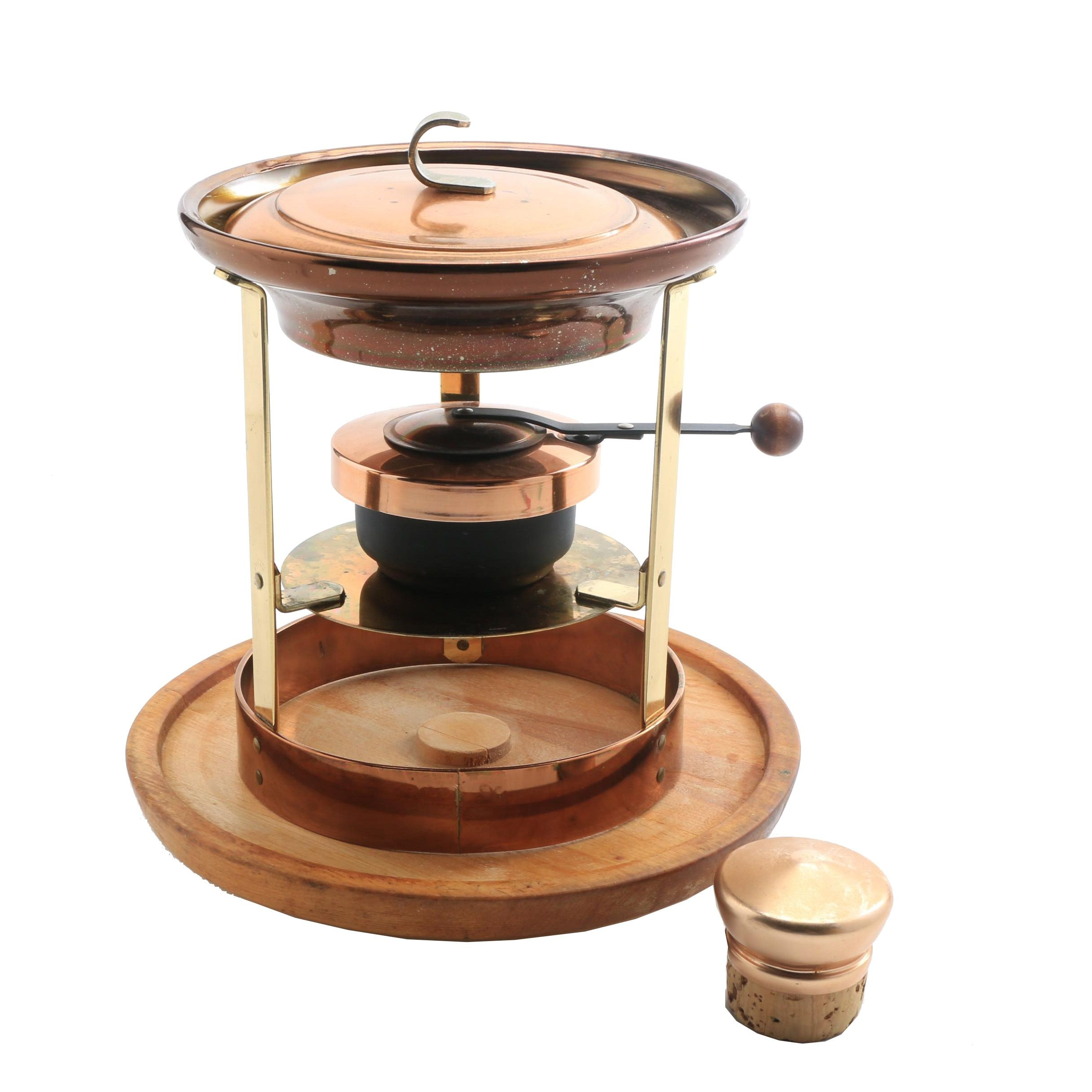 copper and brass fondue stand and carved wood lazy susan