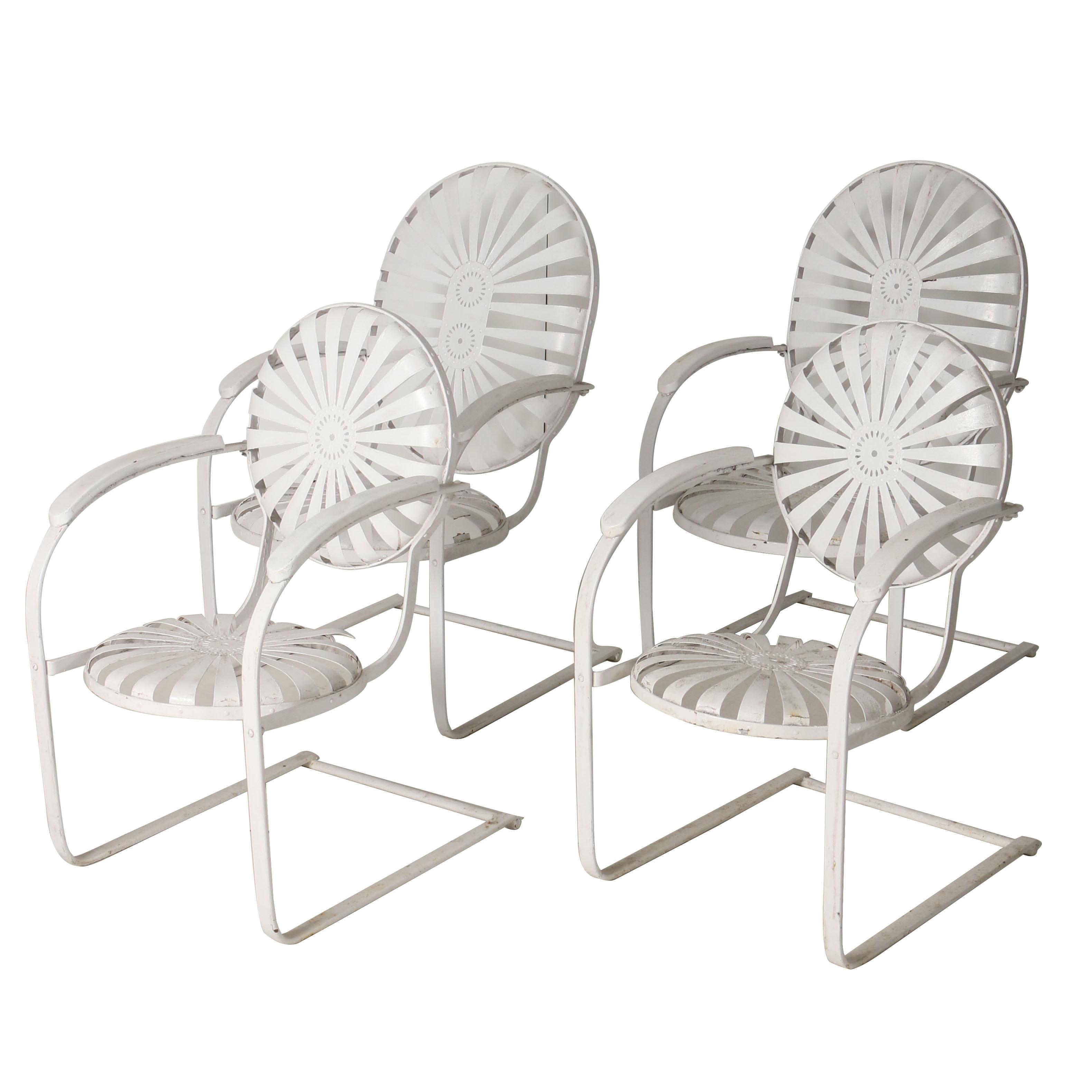 Four Vintage Sunburst Spring Back Chairs