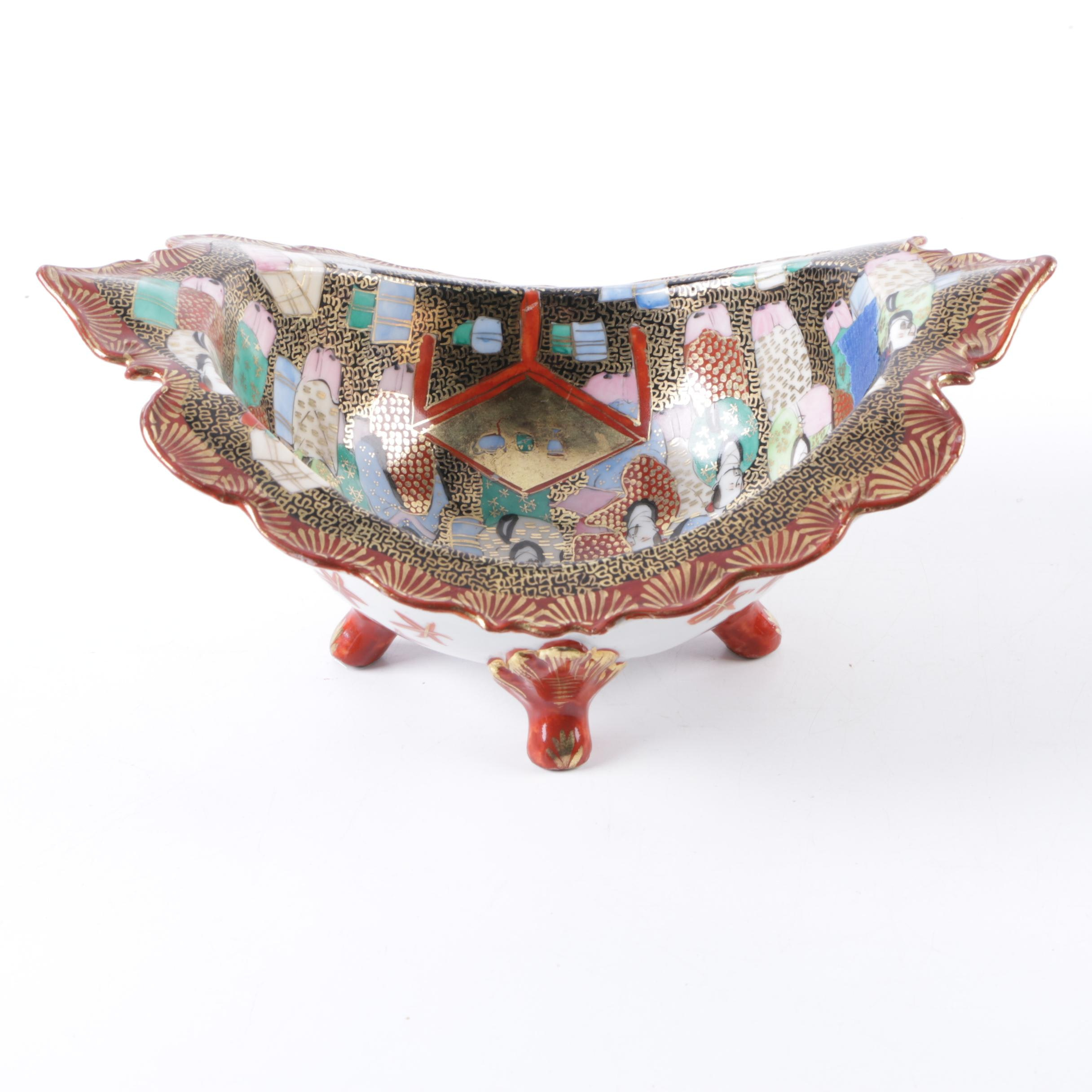 Japanese 'Thousand Faces' Footed Porcelain Dish