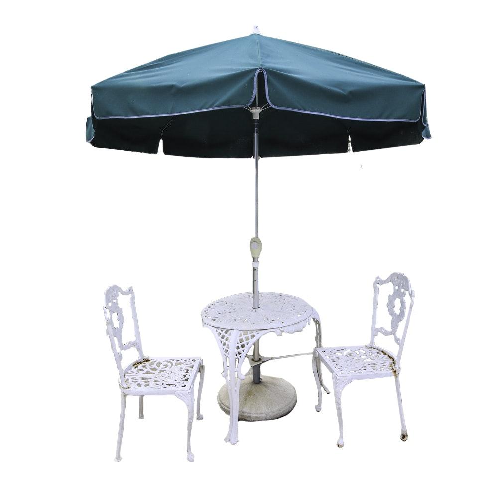 Three-Piece Cast Iron Bistro Set with Patio Umbrella