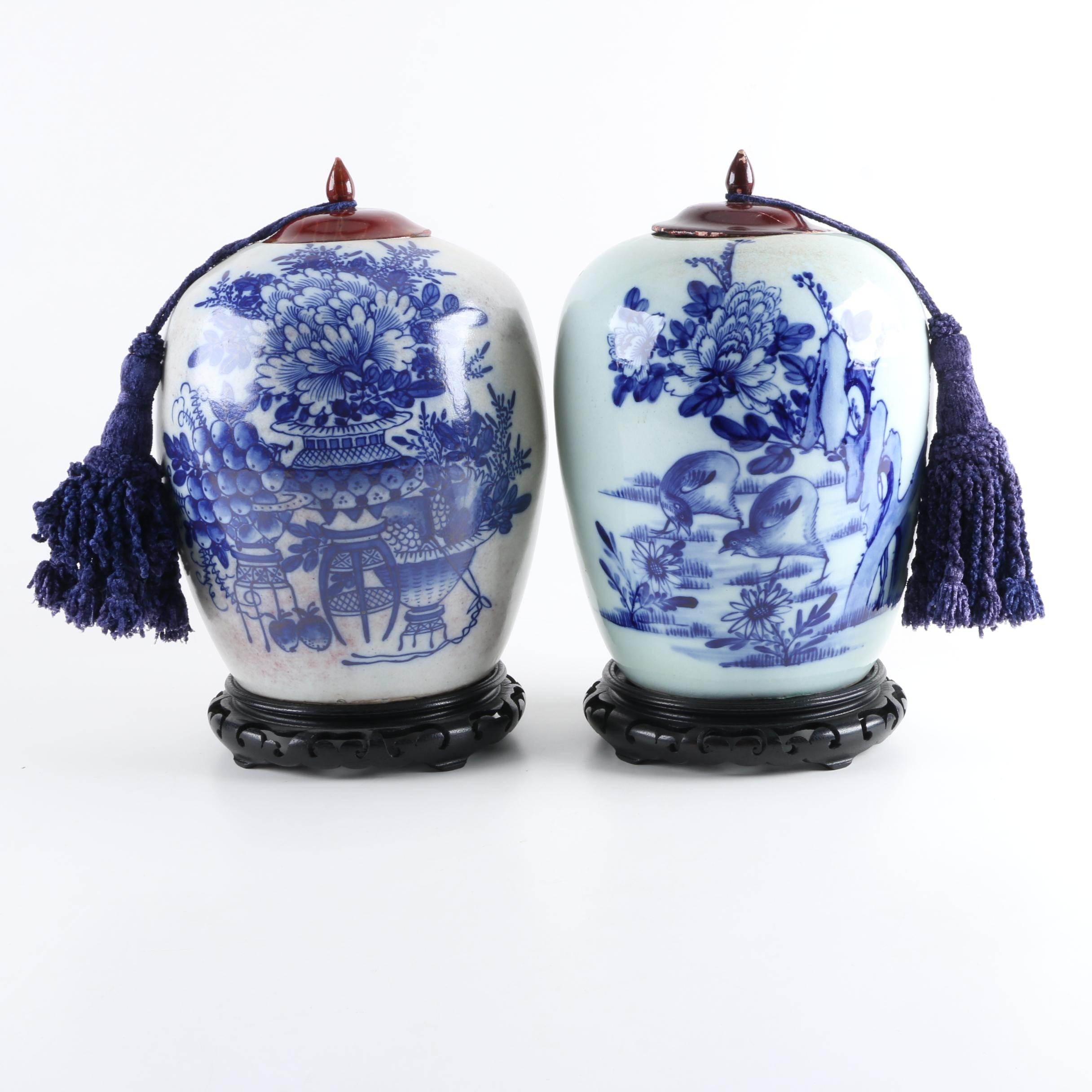 Pair of Chinese Ceramic Jars with Carved Wooden Stands