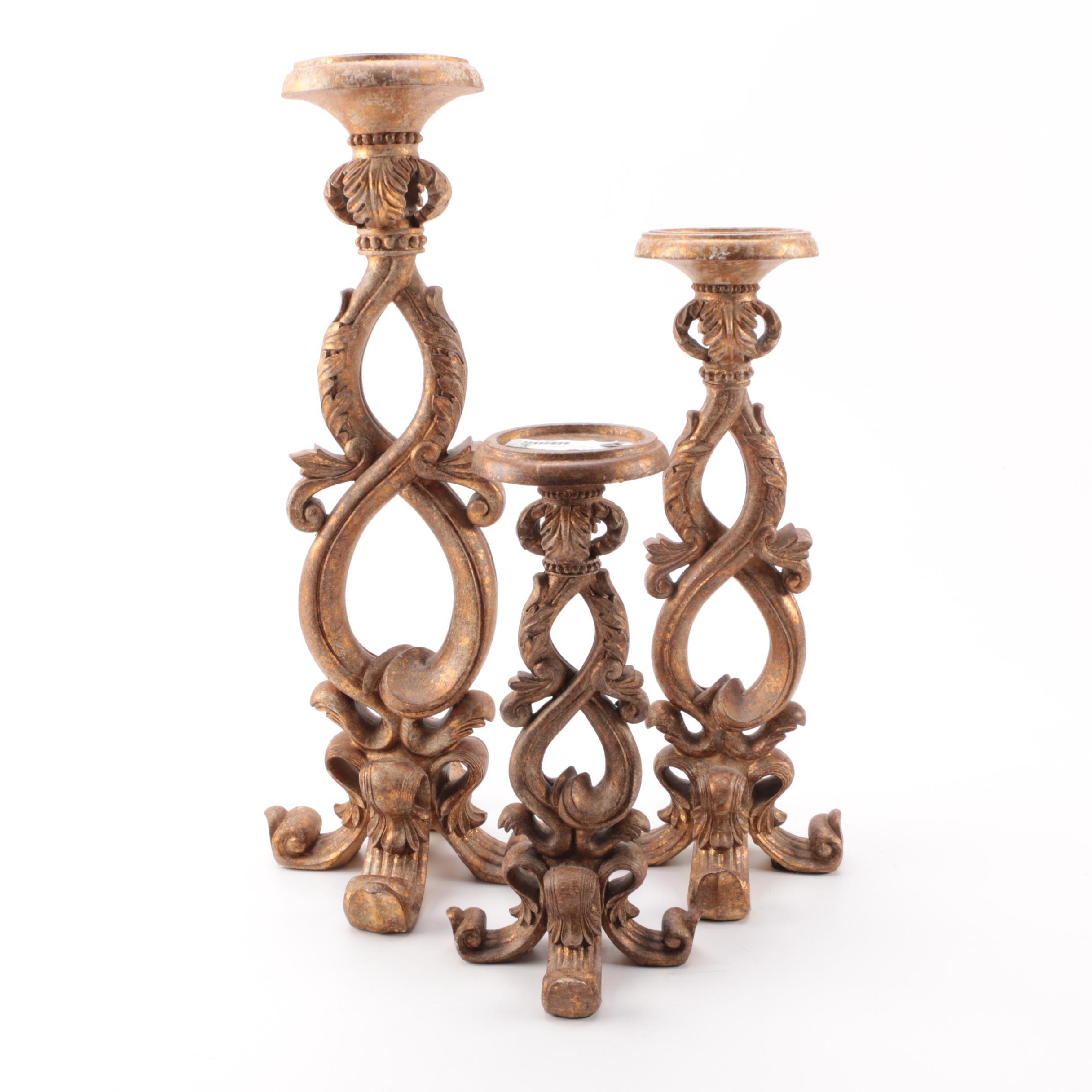 Set of Ornately Carved Candleholders