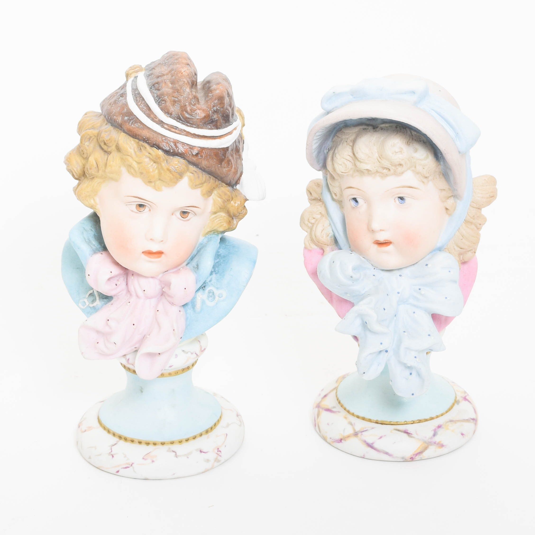 Pair of Antique Bisque Porcelain Busts
