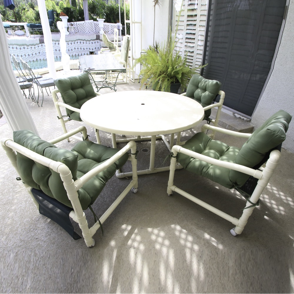 Patio Table with Tubular Frame and Four Matching Chairs