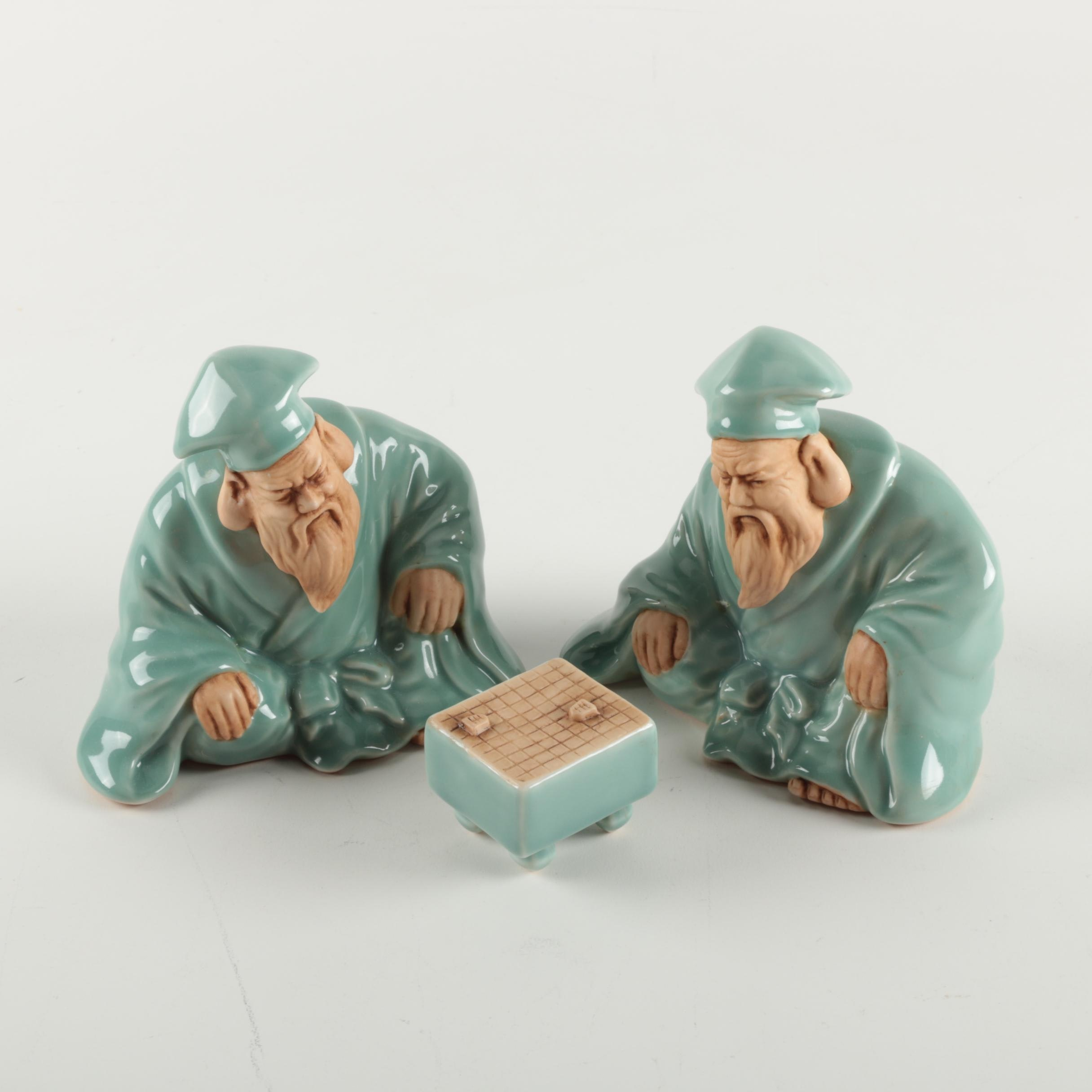 Asian Inspired Ceramic Figurines Depicting Men With Table Game