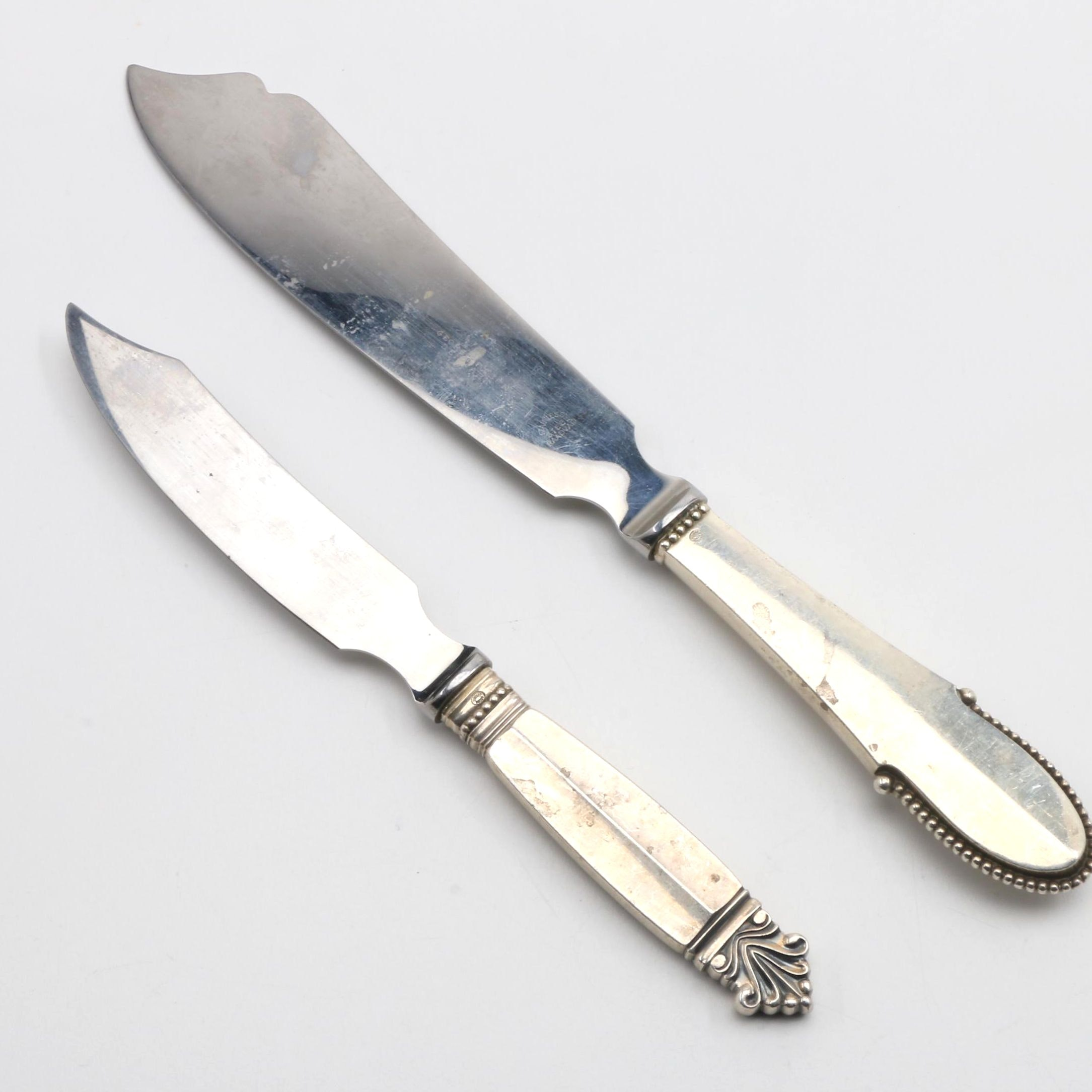 "Georg Jensen Sterling Serving Knives in the ""Beaded"" and ""Acanthus"" Patterns"