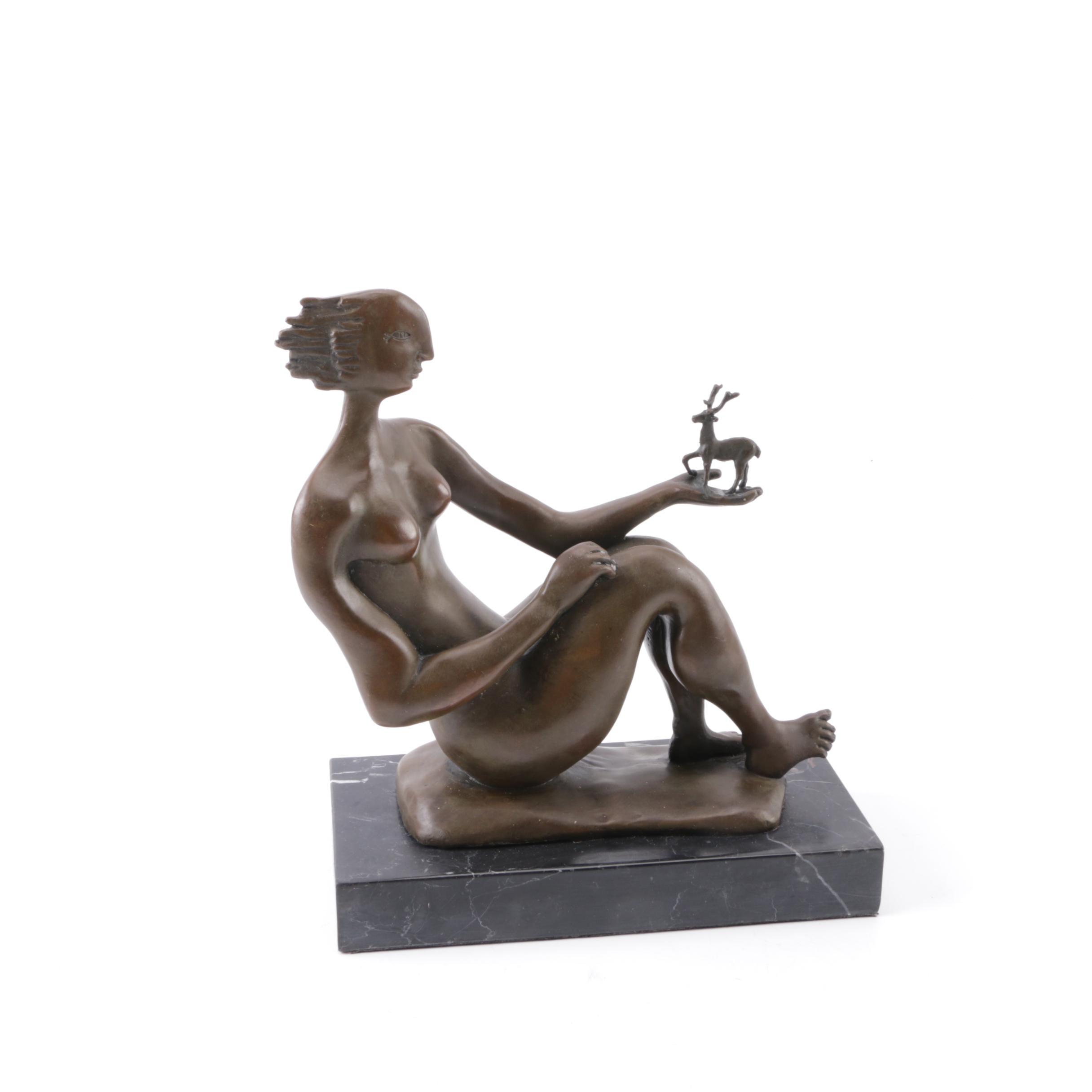 Bronze Sculpture of a Woman Holding a Deer