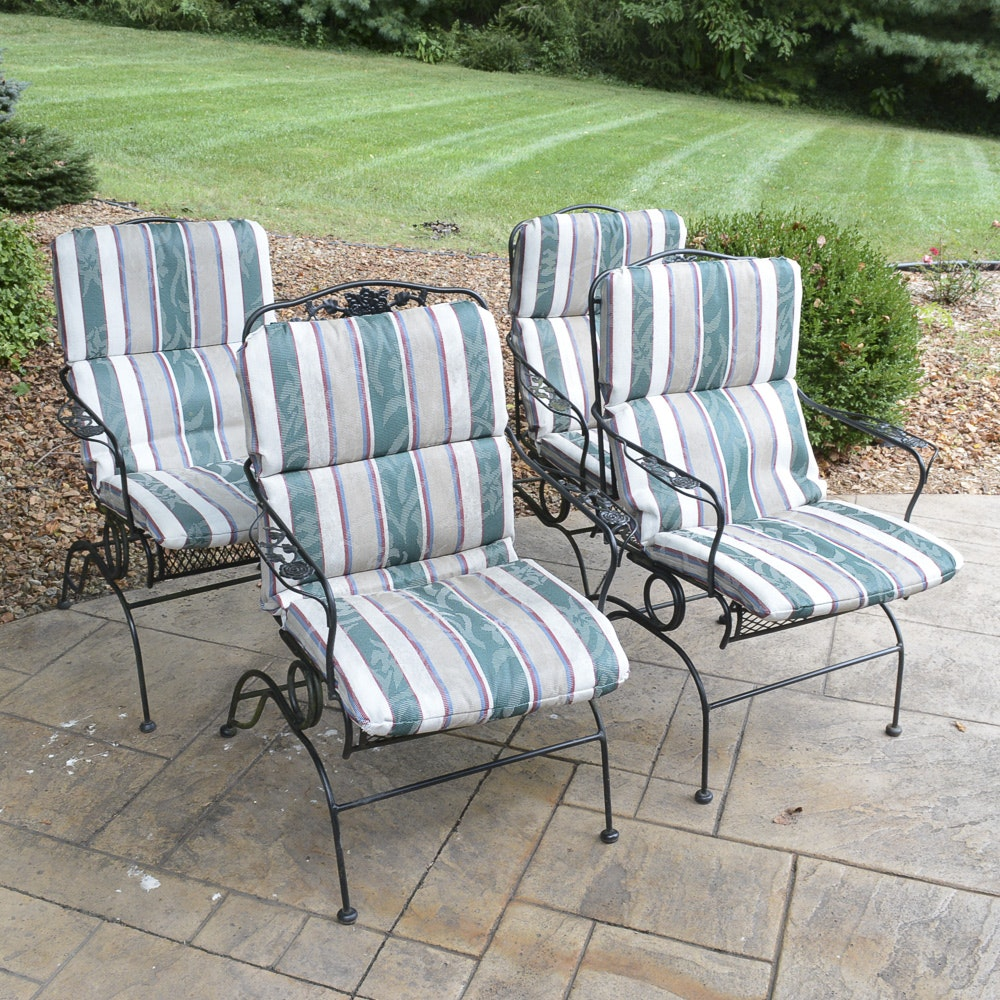 Four Metal Outdoor Chairs with Cushions