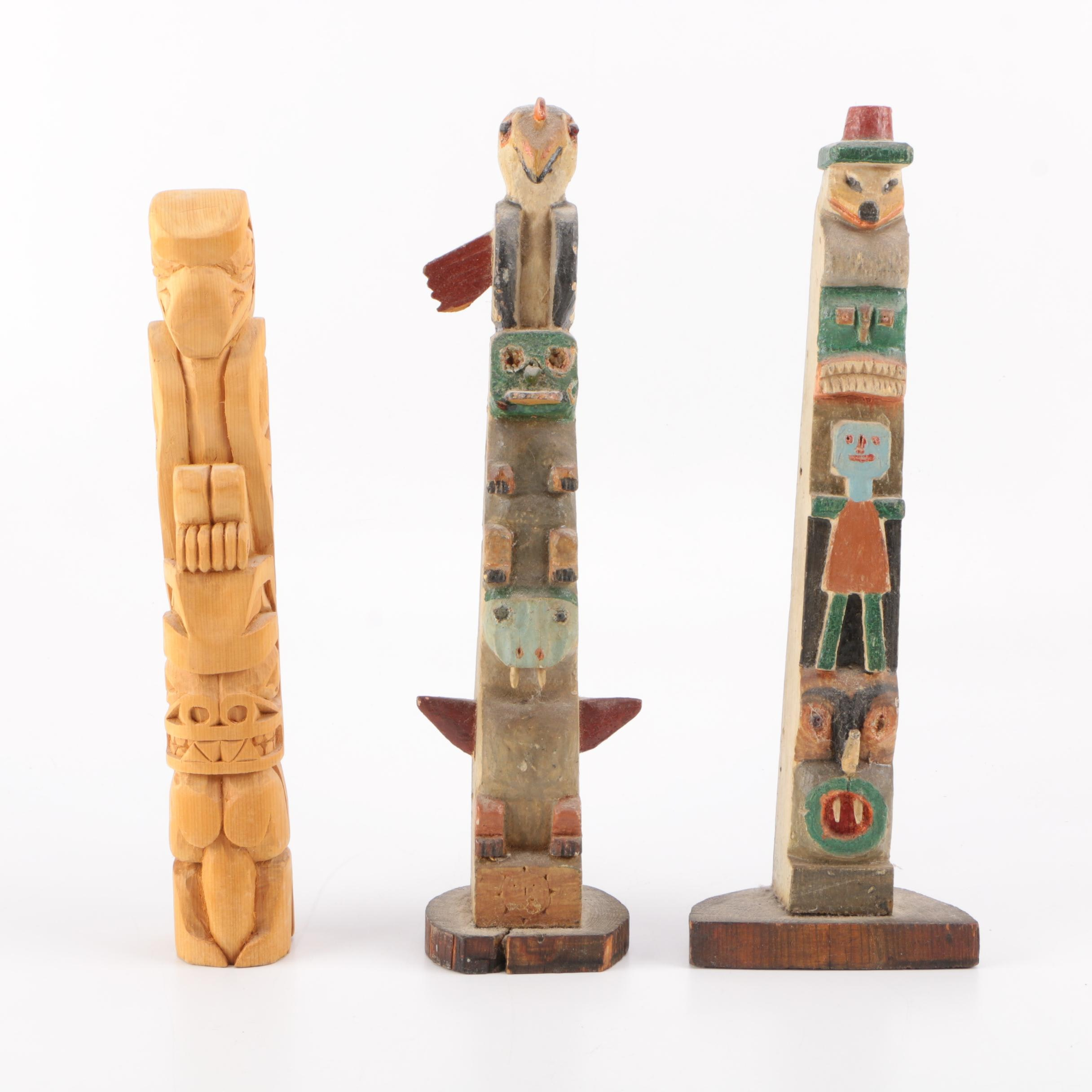 A Collection of Three Carved Native American Style Totems