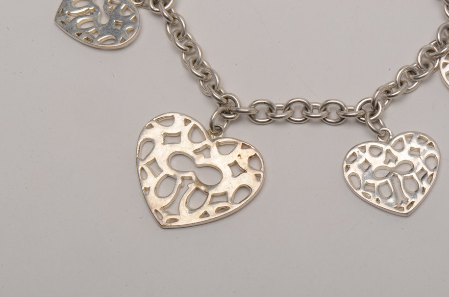 Coach Sterling Silver Bracelet With Heart Shaped Charms Ebth