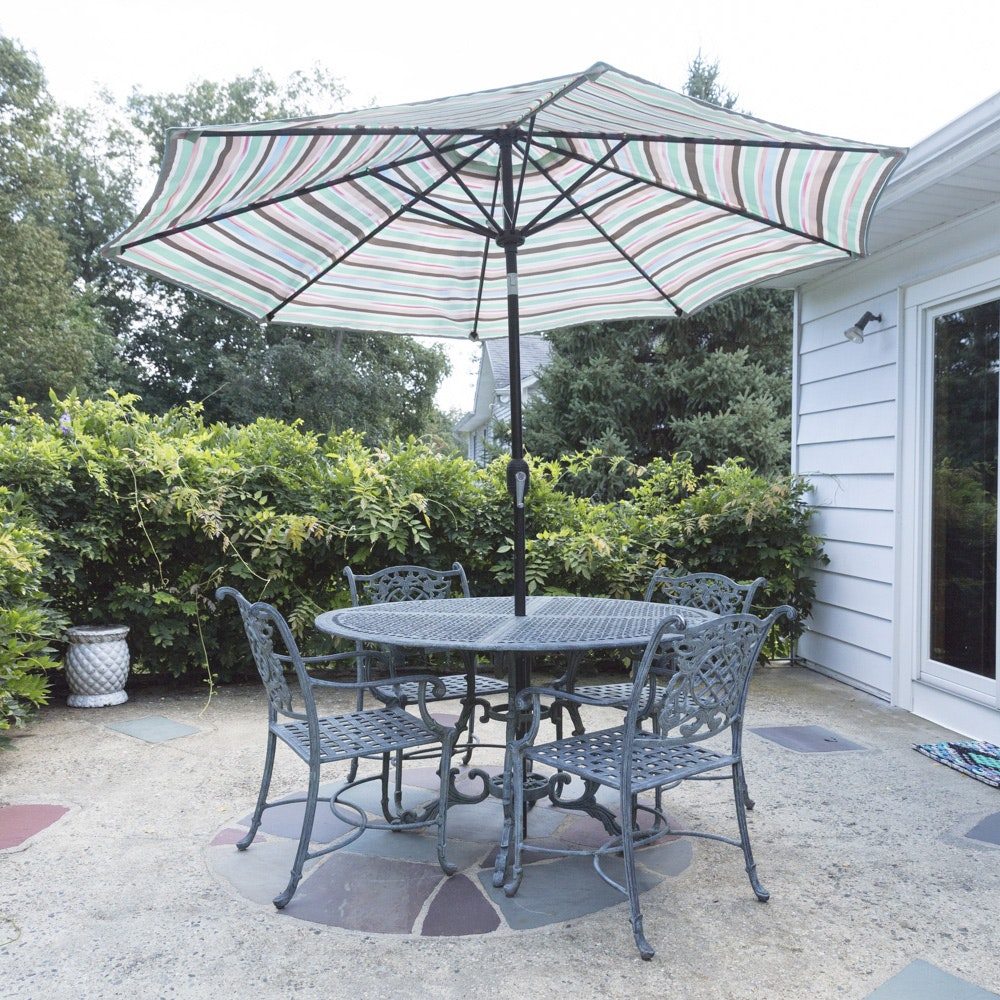 Antiqued Metalwork Patio Table and Chairs with Umbrella