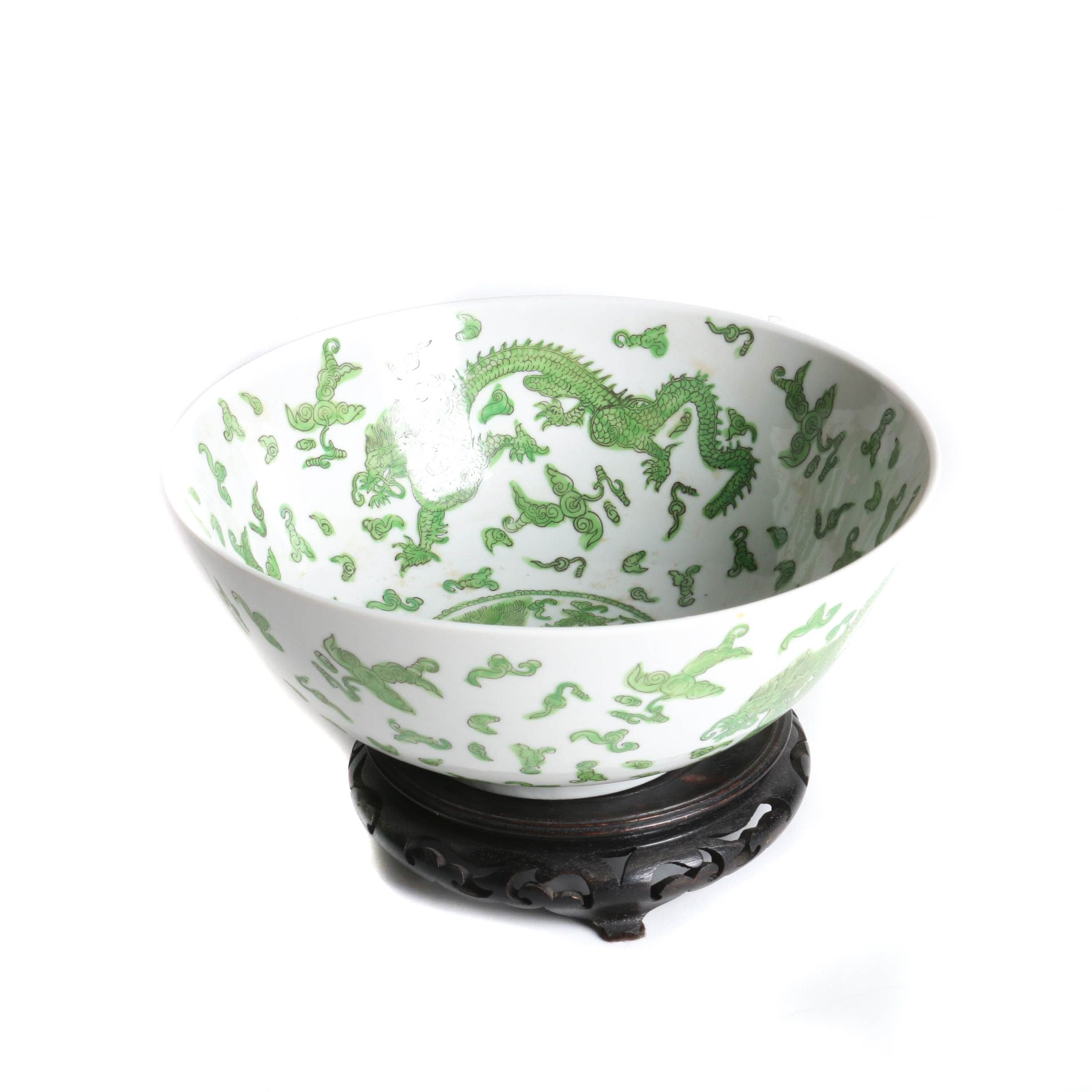 Chinese Green and White Porcelain Bowl with a Dragon Motif and a Wooden Stand