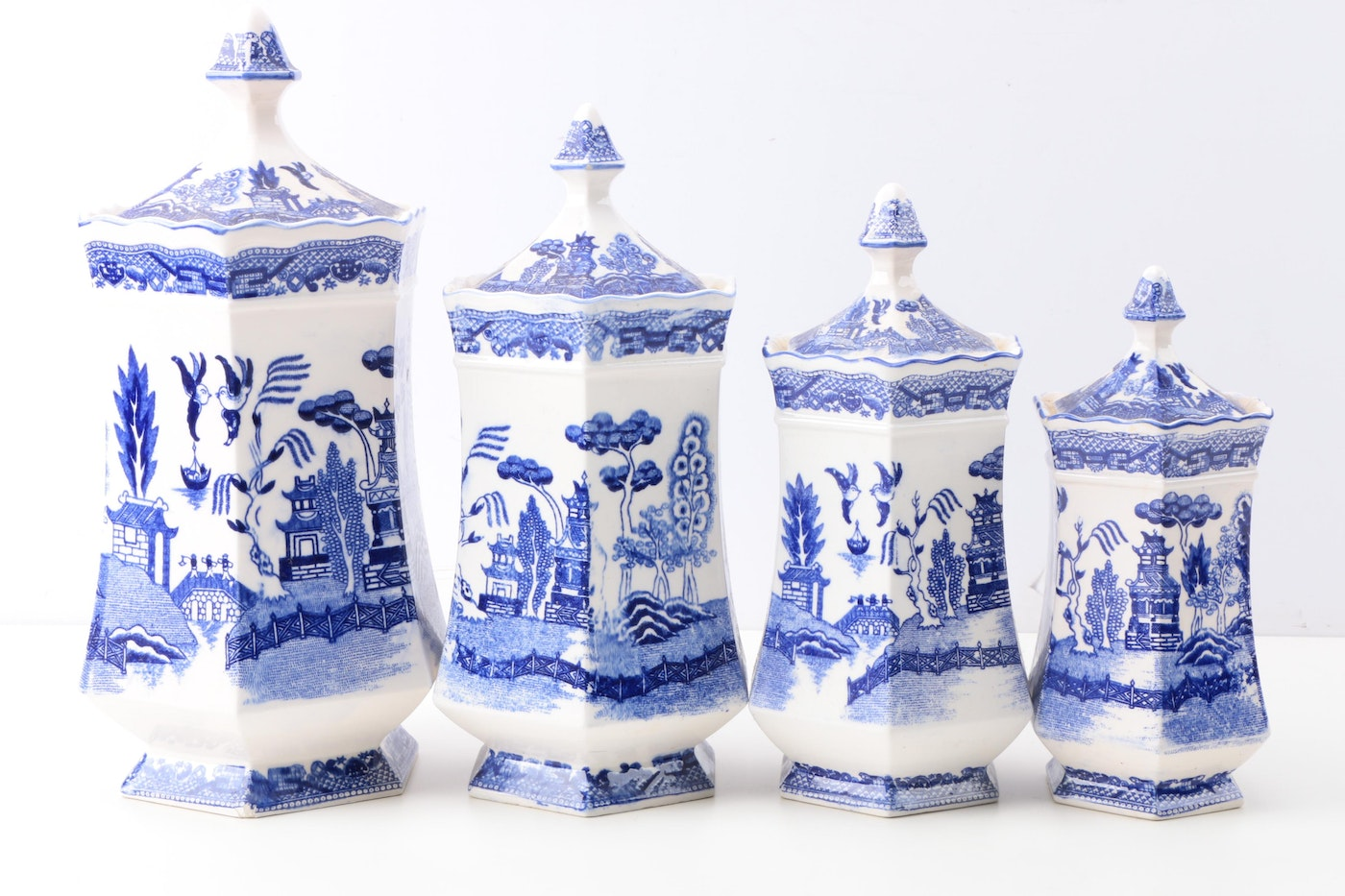 Quot Blue Willow Quot Transferware Ceramic Canisters And Cobalt Blue Glass Vase Ebth