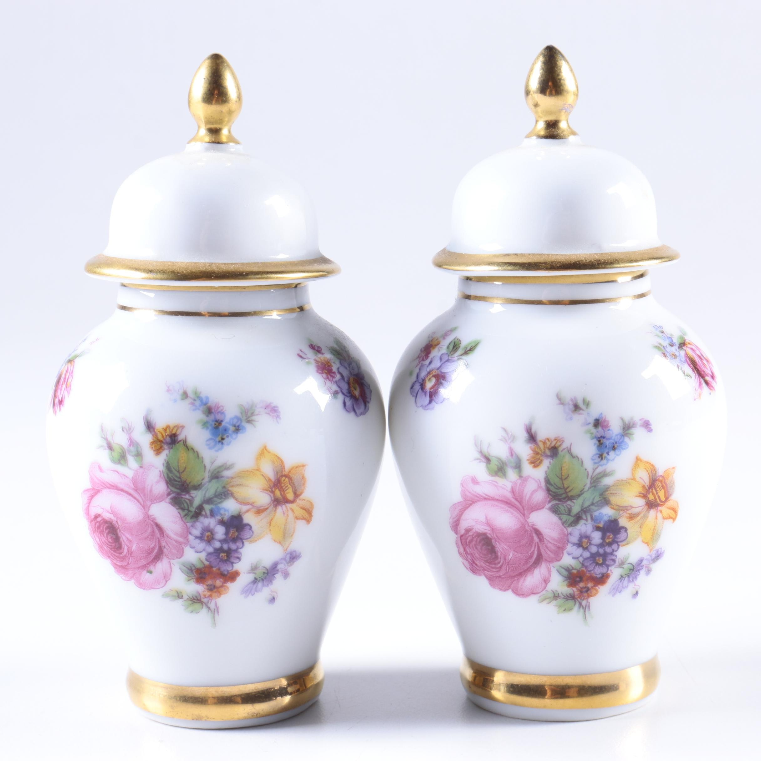 Pair of Lidded Porcelain Urns with Floral Motif