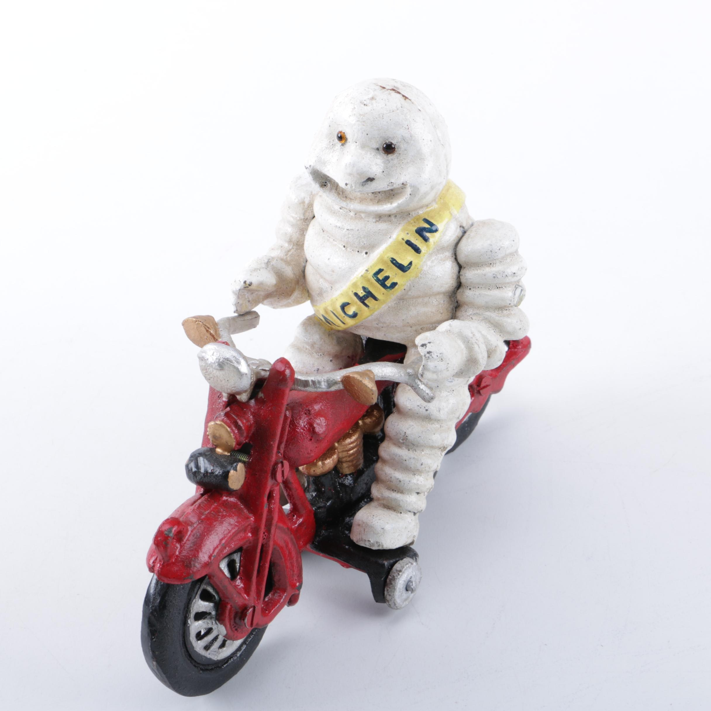 Reproduction Cast Iron Michelin Man on a Motorcycle