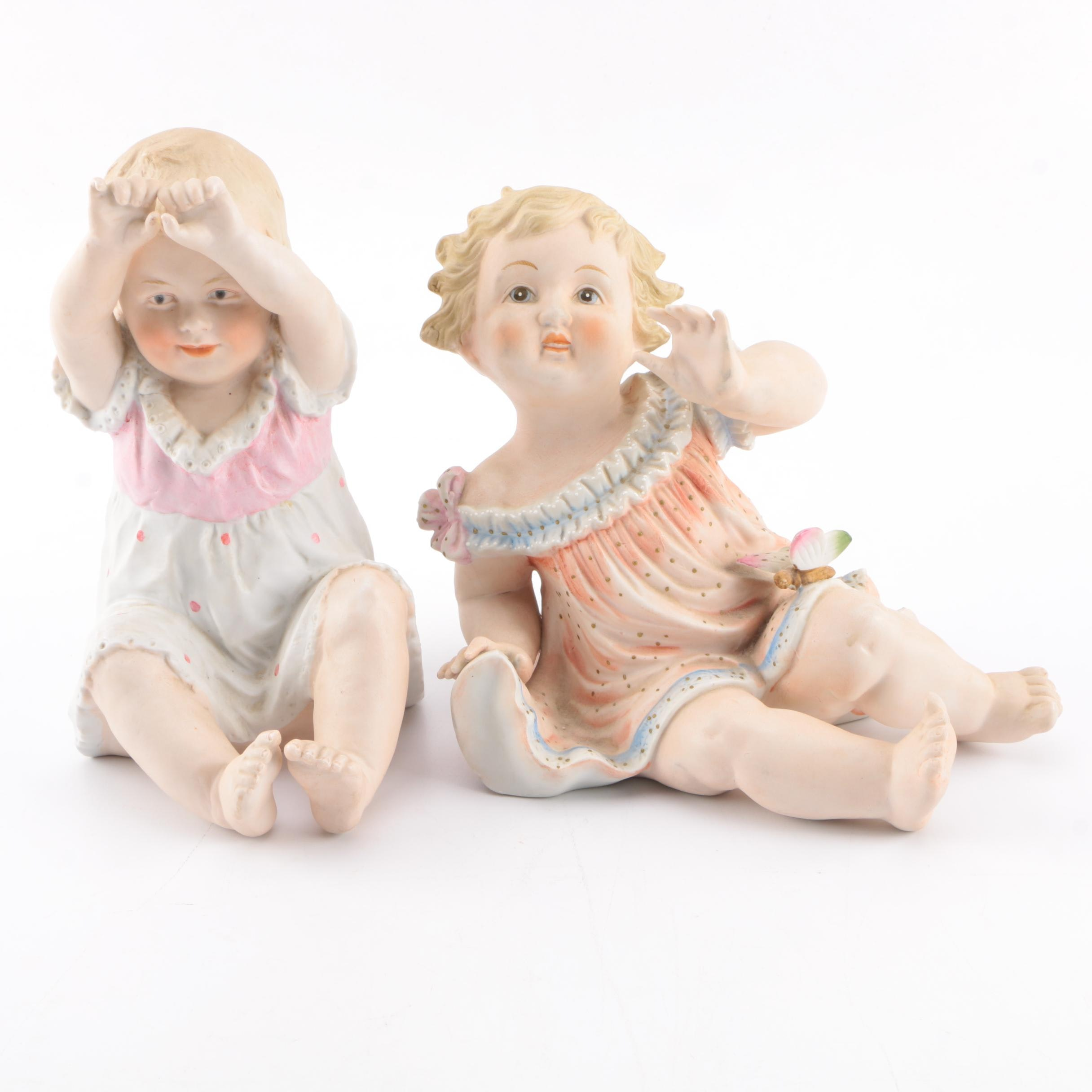 Pair of Porcelain Infant Figurines