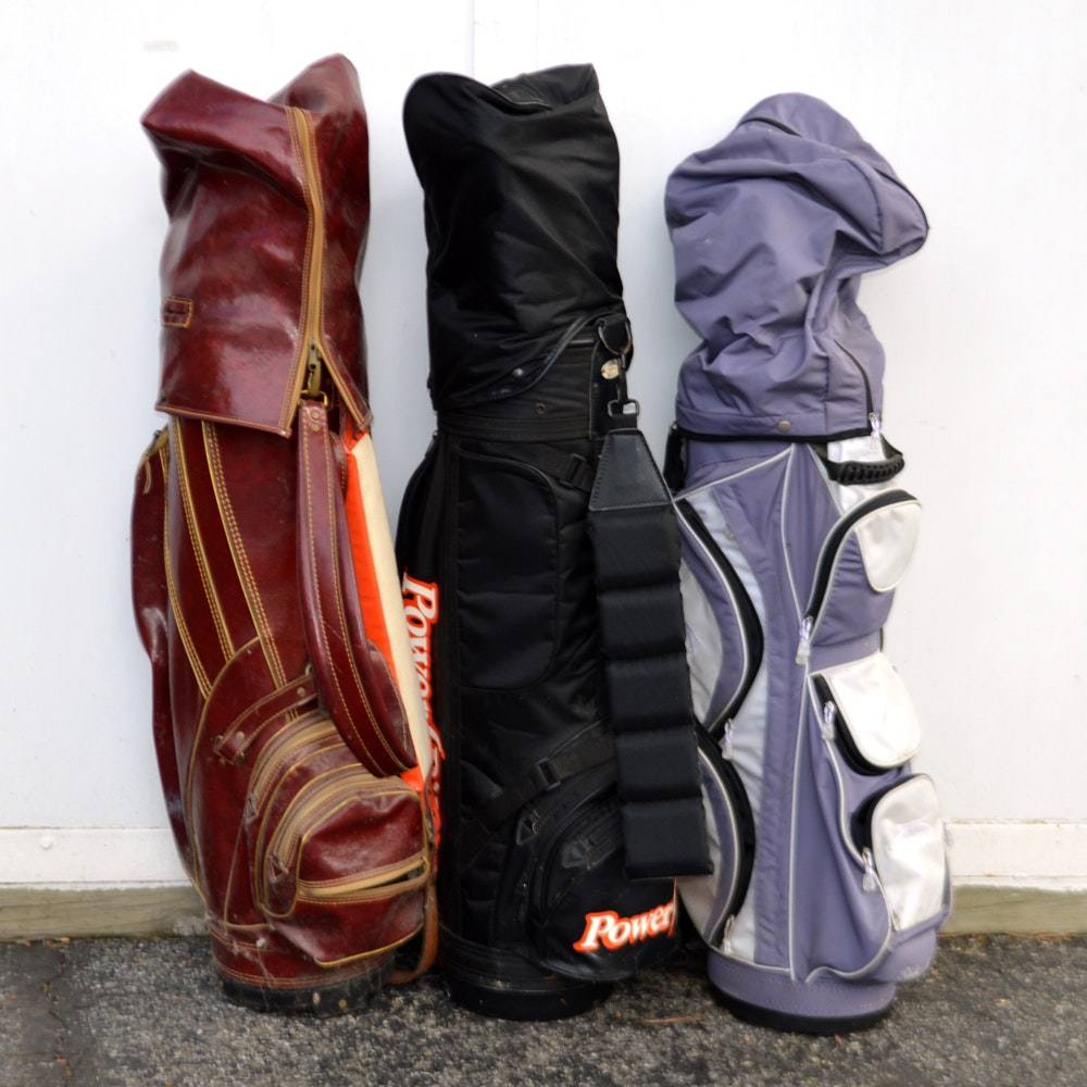 Three Golf Bags with Clubs