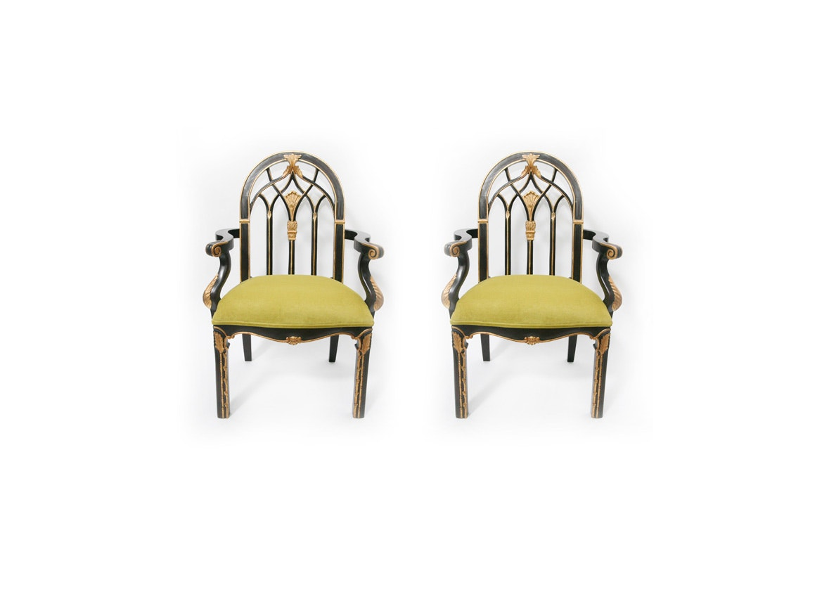 Pair of Highly Stylized Black And Gilt Carved Arch Back Armchairs