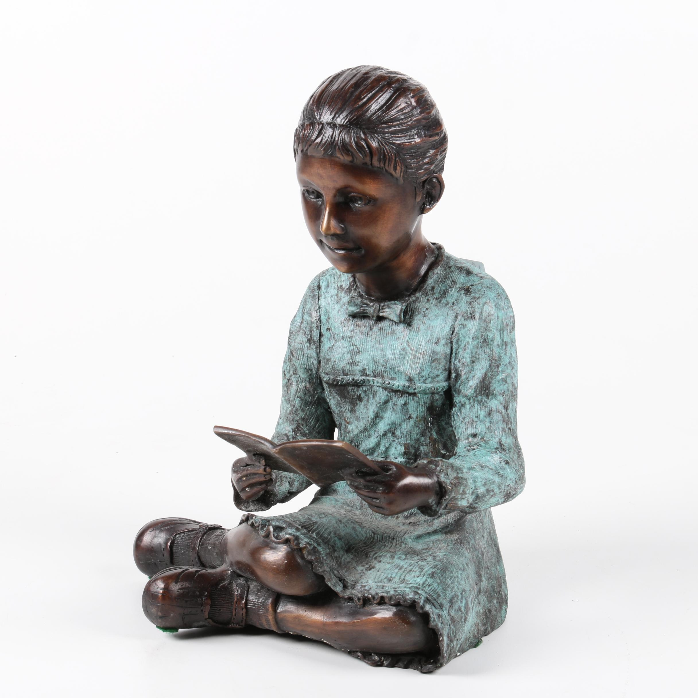 Metal Statuette of a Girl Reading